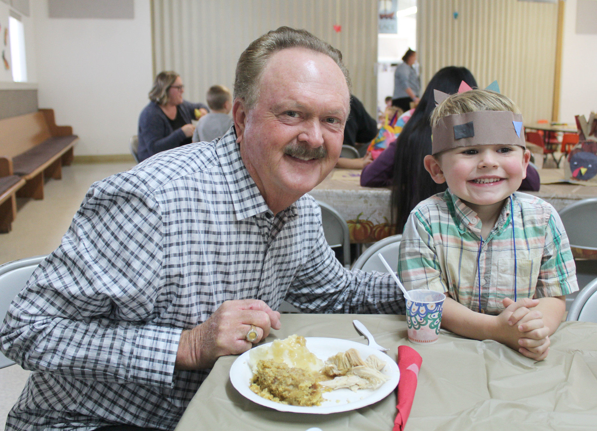 Ronnie Pritchett and his grandson James Fairbanks, 3, enjoy their time at the traditional Thanksgiving meal.