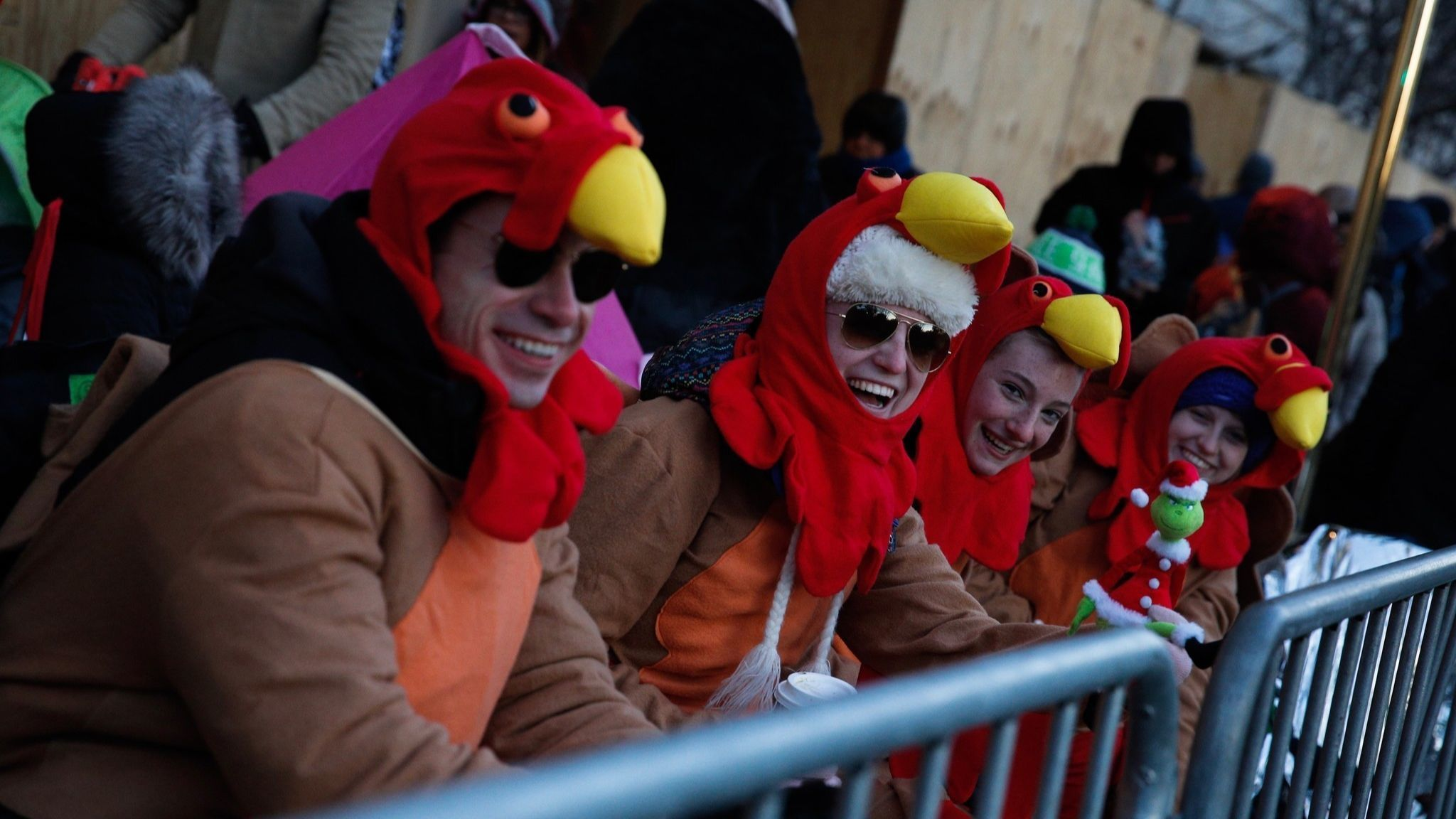 People try to stay warm before the 92nd annual Macy's Thanksgiving Day Parade in New York, Thursday,