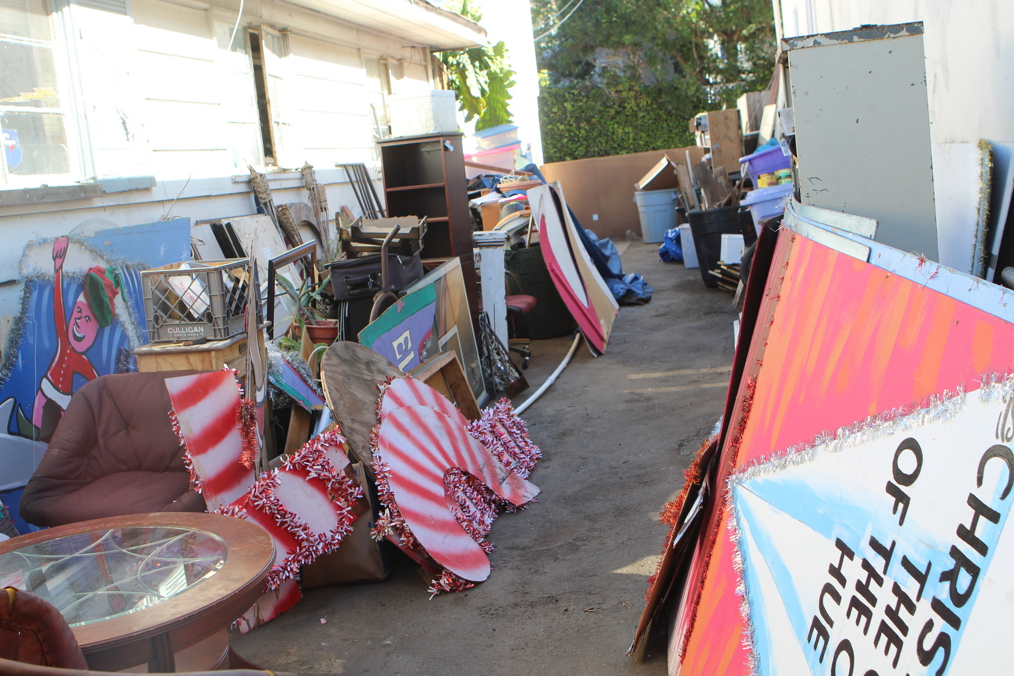 Glancy no longer has anywhere to store the old parade float signs stored outside his Bird Rock plumbing business.