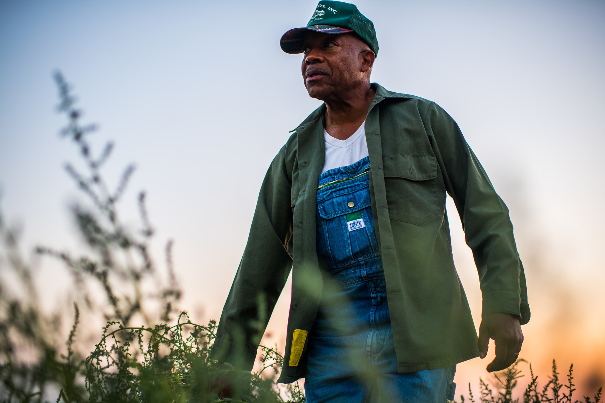 Dennis Hutson checks irrigation valves in his alfalfa fields in Allensworth California on August 12,