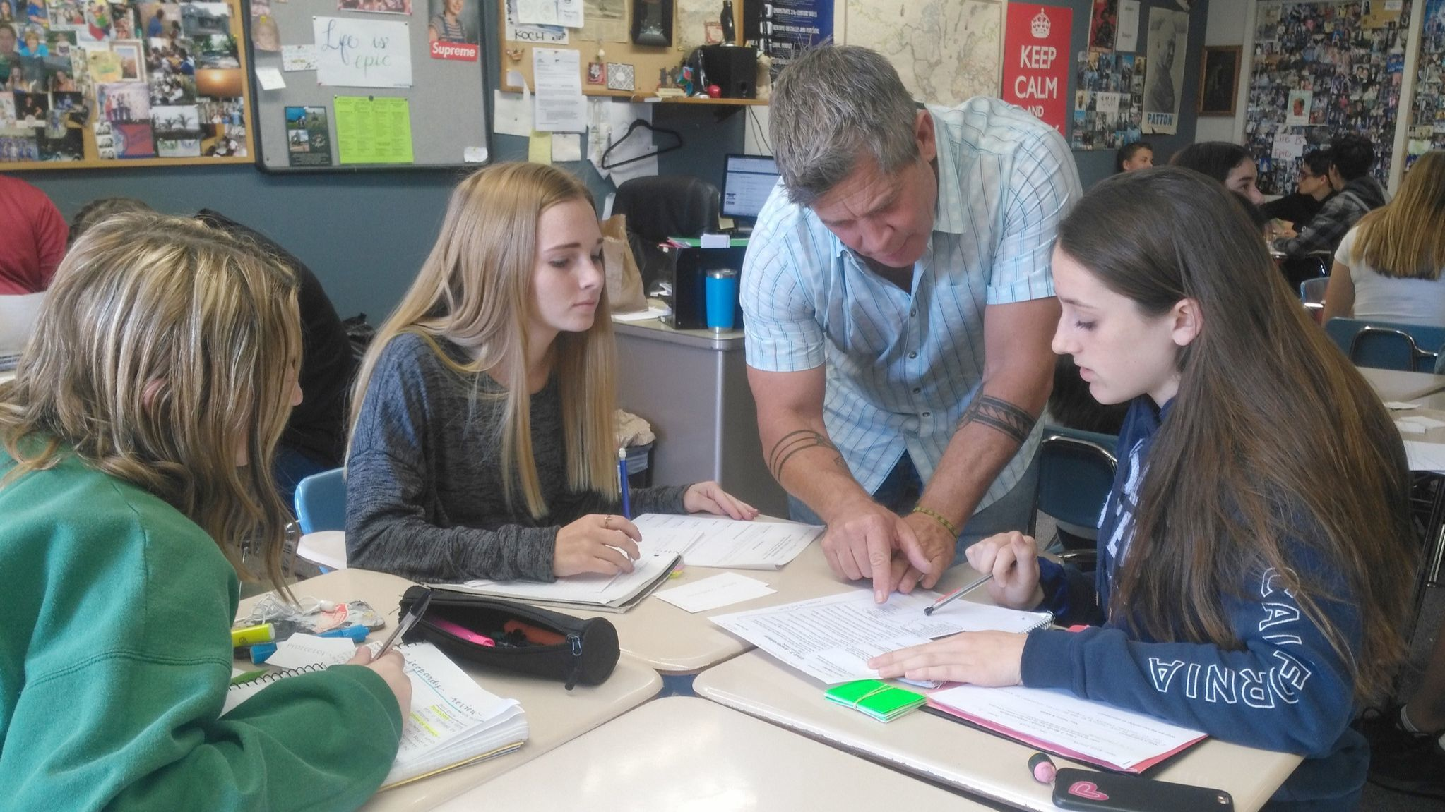 Teacher Steve Koch gives individual attention to Ramona High freshmen, from left, Sky Cameron, Taylor Smith and Elsie Shultz.