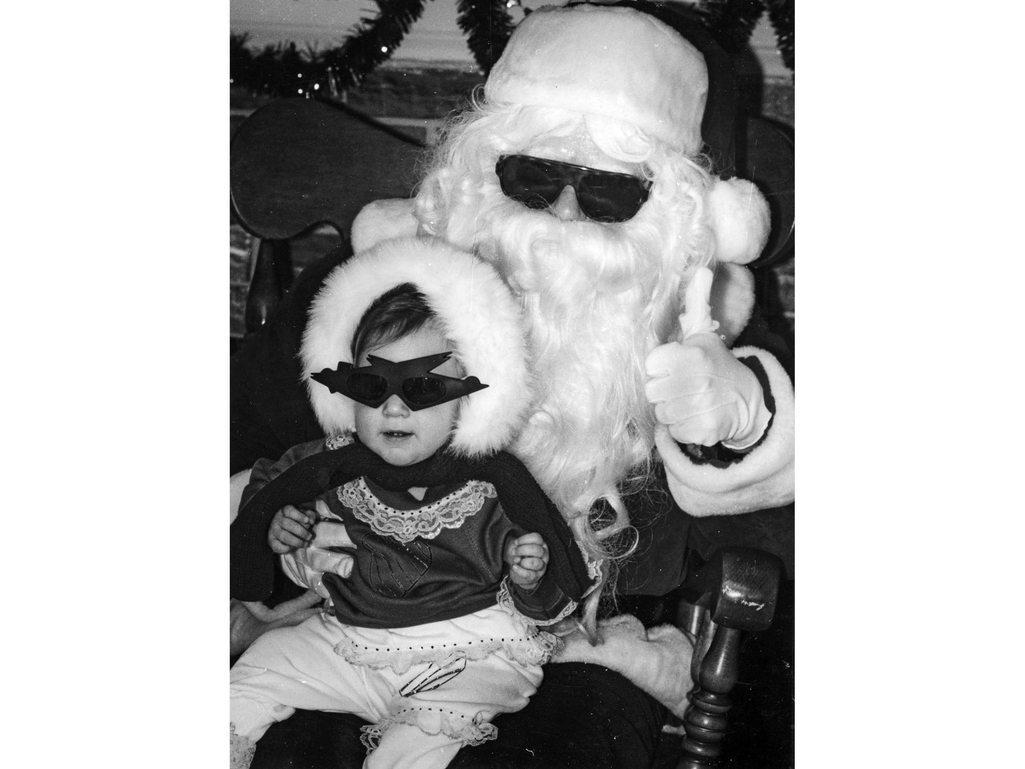 Dec. 8, 1990: Santa wears sunglasses to match Olivia Senecal, 11-month, at the Rolling Hills Plaza.