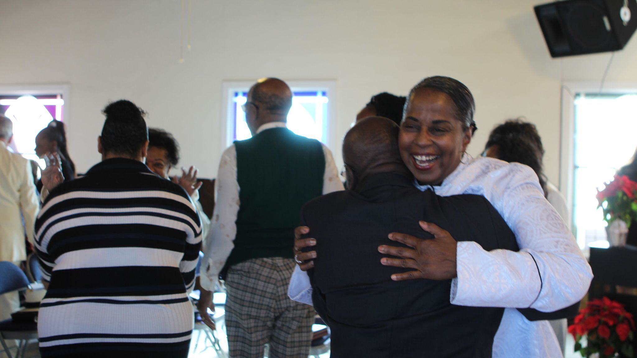 Rev. Denise Jackson greets congregants of Prince Chapel following her sermon on Sunday morning, Dec. 2.