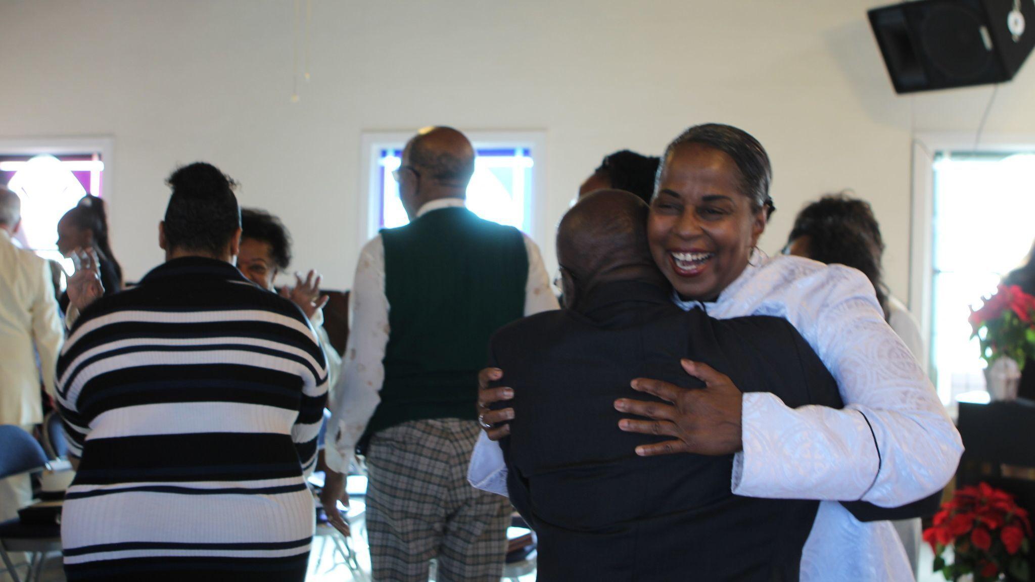 Rev. Denise Jackson greets congregants of Prince Chapel following her sermon on Sunday morning, Dec. 2.