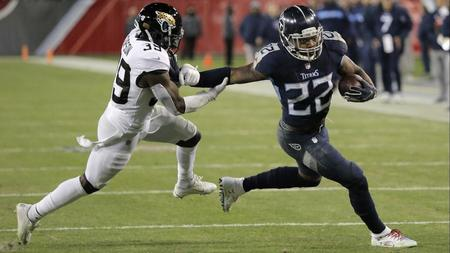 e5569627a Derrick Henry runs into record book as Titans pound Jaguars
