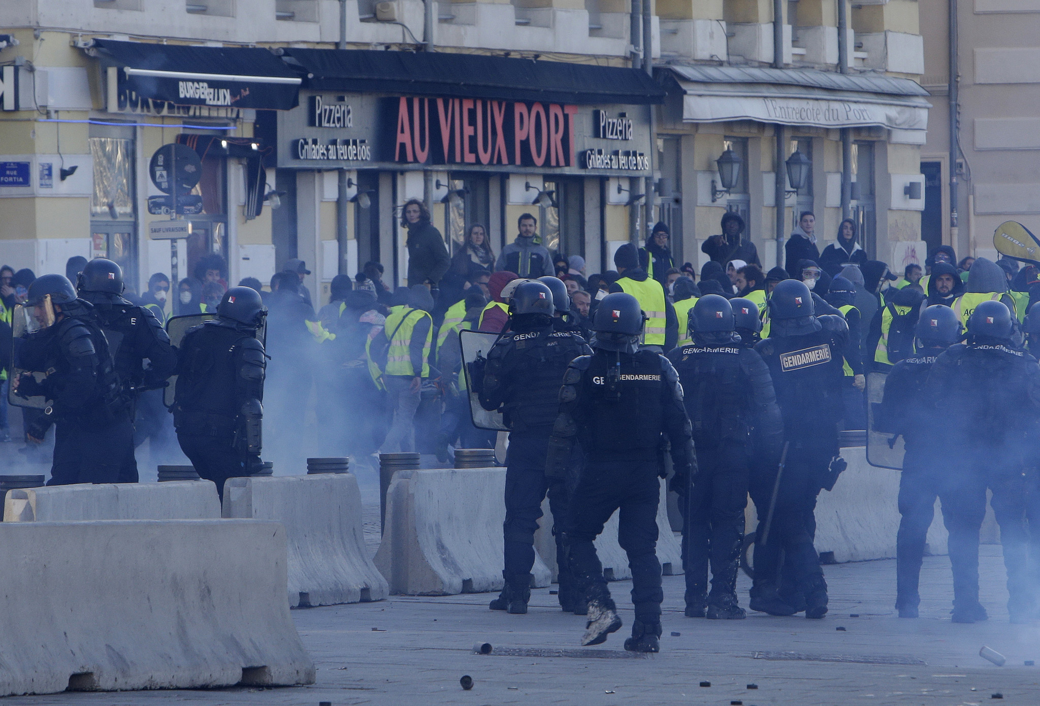 Paris cleans up after latest riot; pressure builds on Macron