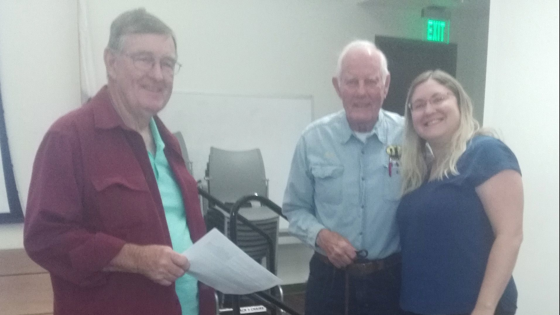 Ramona Trails Association members Don Wendt, left, and John Degenfelder confer with San Diego County Trails Program Coordinator Meg Diss at the Santa Maria Creek Greenway meeting.