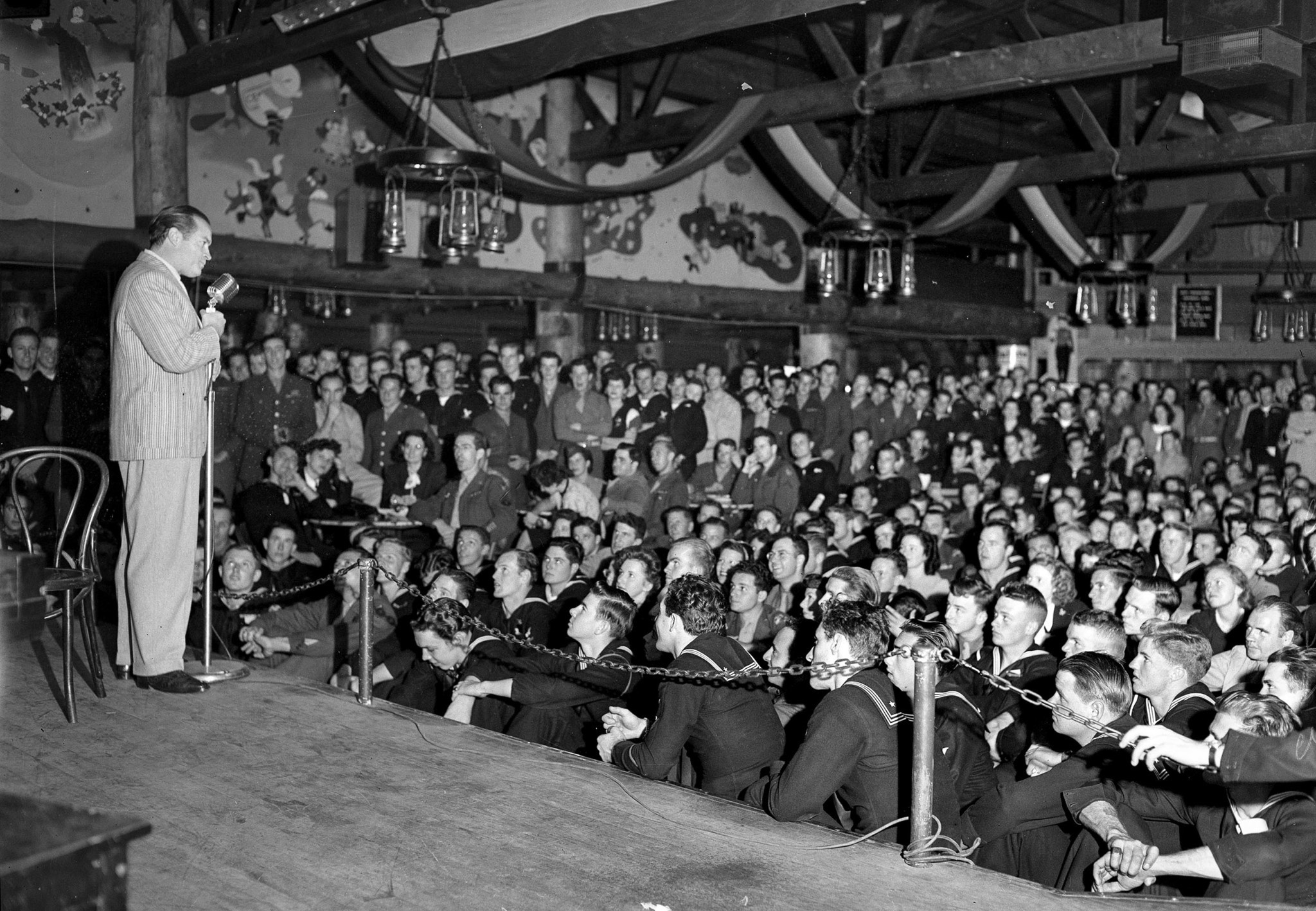 1945: Bob Hope performing for servicemen at the Hollywood Guild and Canteen. This photo is from the