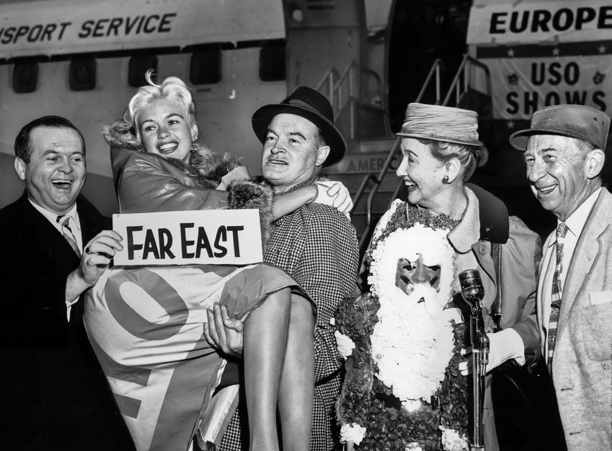 Dec. 16, 1957: Bob Hope gives actress Jayne Mansfield a lift as a USO troupe prepares to leave for