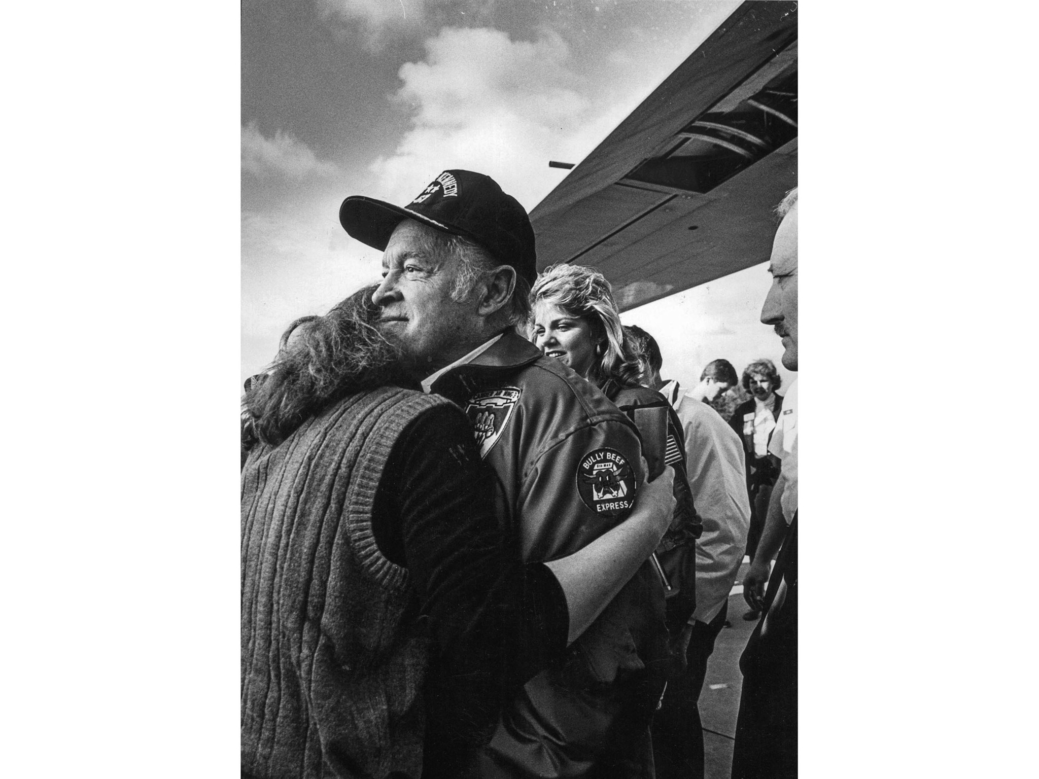 Dec. 27, 1983: Bob Hope gets a hug from an unidentified fan upon his return to Van Nuys Airport afte