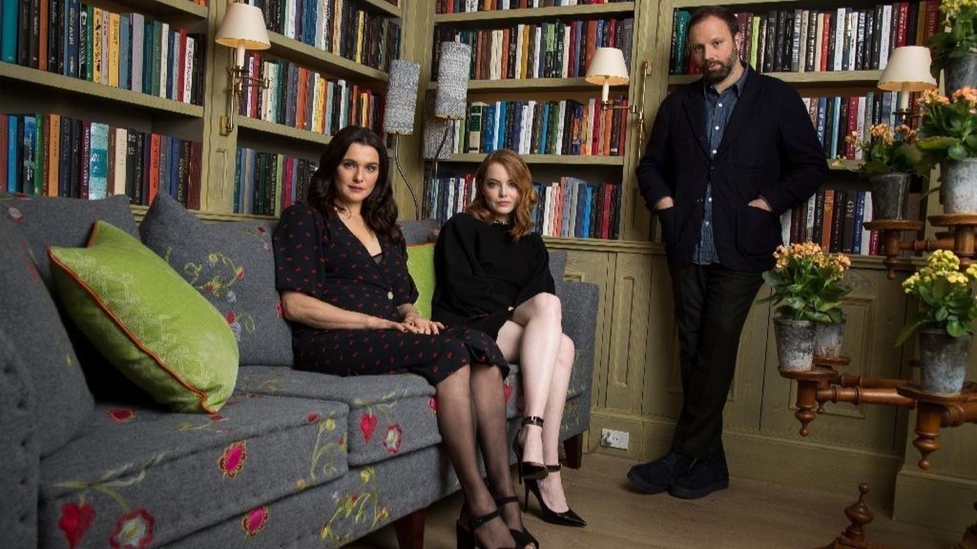 """""""I'm not big on realism,"""" notes director Yorgos Lanthimos, right, of his subversive costume drama """"The Favourite,"""" starring Rachel Weisz, left, and Emma Stone."""