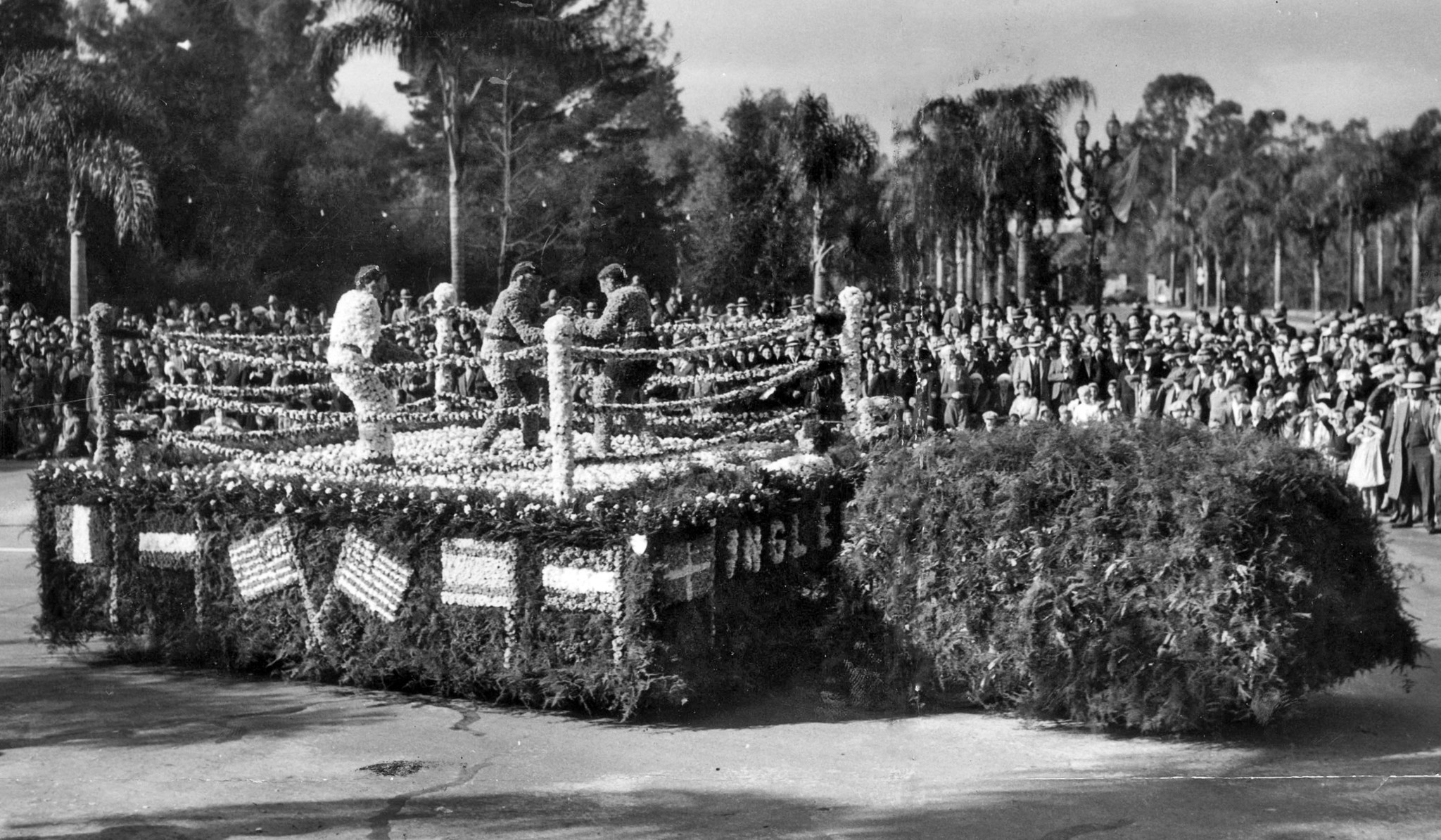 "Jan. 1, 1932: City of Inglewood float titled ""Boxers"" in the Tournament of Roses parade. Written on"