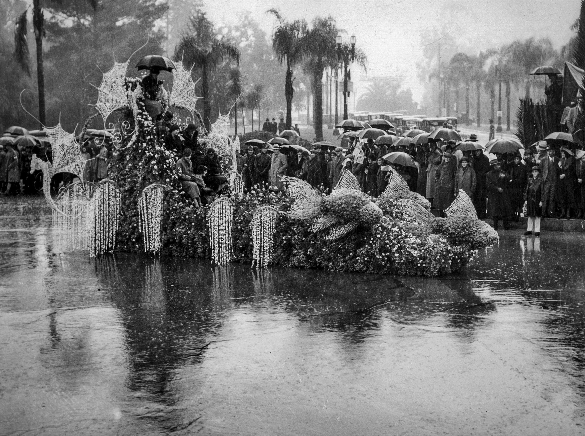 Jan. 1, 1934: Tournament of Roses queen Treva Scott, top of float with umbrella, and her court durin