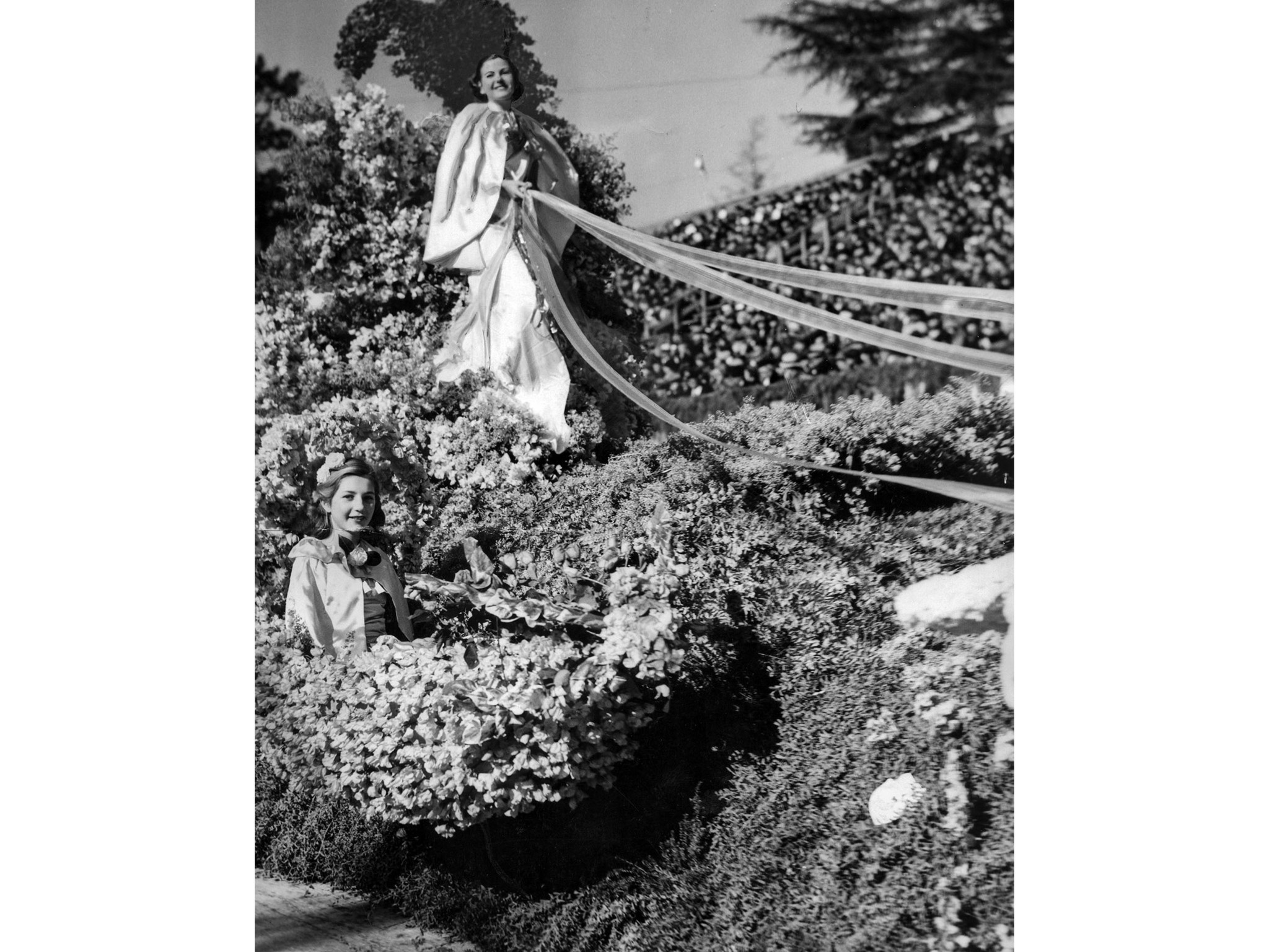 "Jan. 1, 1937: Tournament of Roses queen Nancy Bumpus on float with theme ""The Romance of the Rose."""