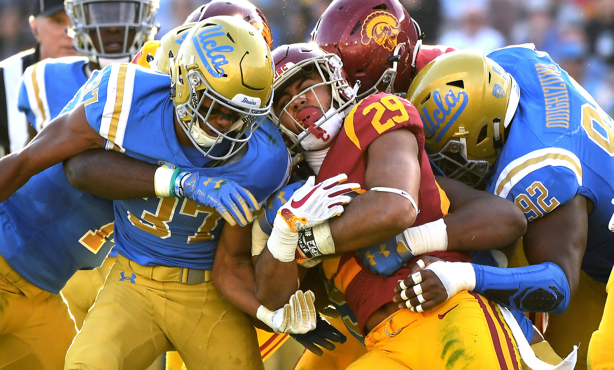 PASADENA, CALIFORNIA OCTOBER 17, 2018-USC running back Vavae Malepeai is stopped by Bruins Quentin L