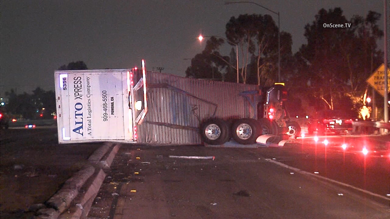 Overturned big rig jams traffic on 10, 110 Freeway