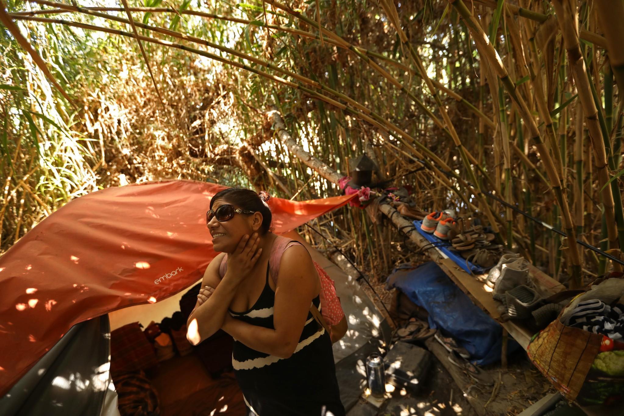 Jenny Gonzalez in a bamboo encampment