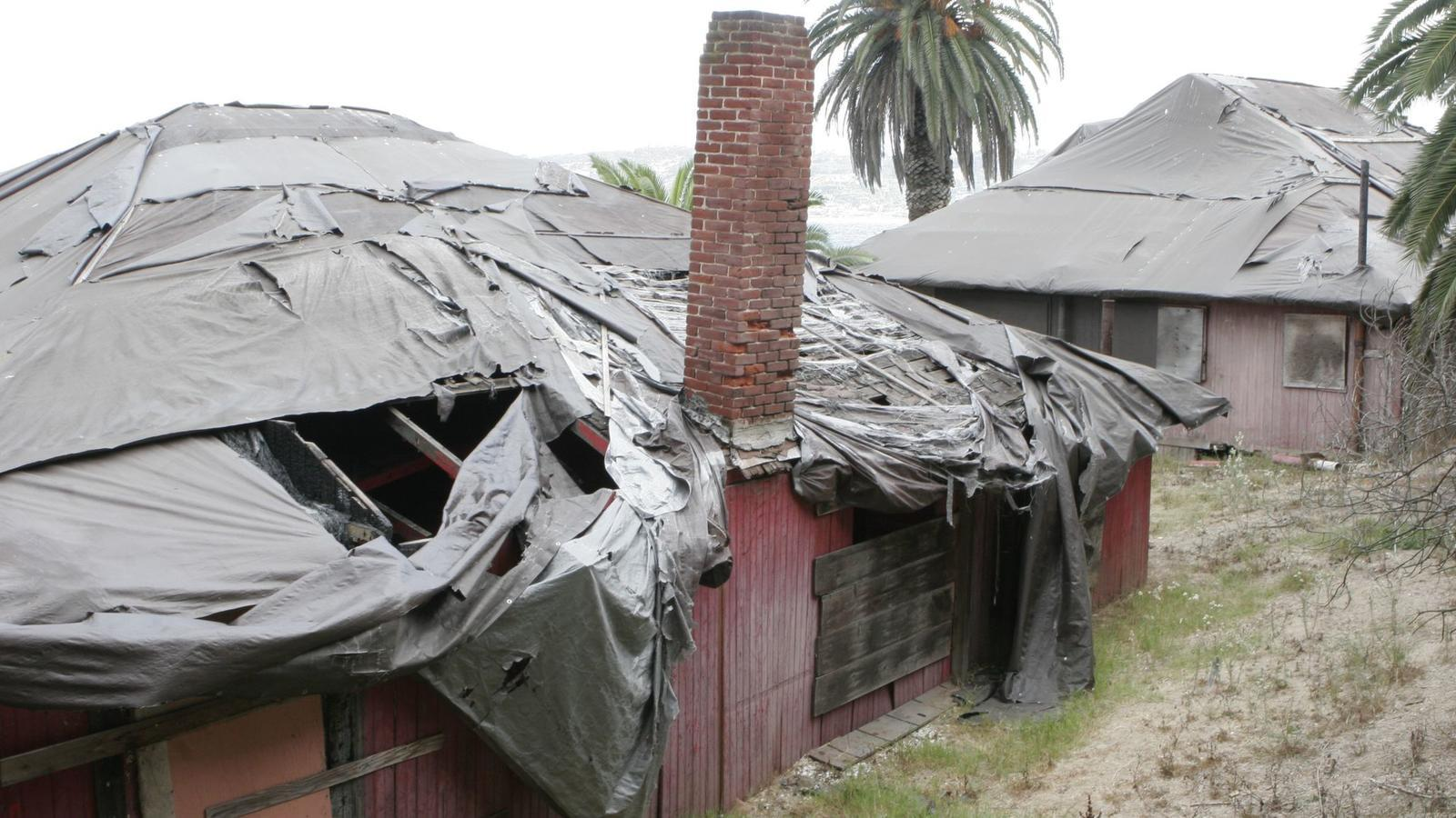The abandoned Red Roost and Red Rest cottages on Coast Boulevard in La Jolla have been a blight on some of California's most desirable real estate for 40 years.