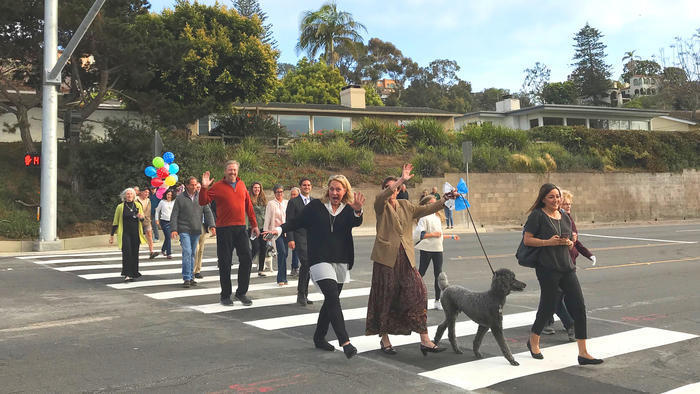 A group of residents from the south side of Torrey Pines Road celebrate the success of their grassroots effort to get the City to install a Hawk pedestrian signal and crosswalk o