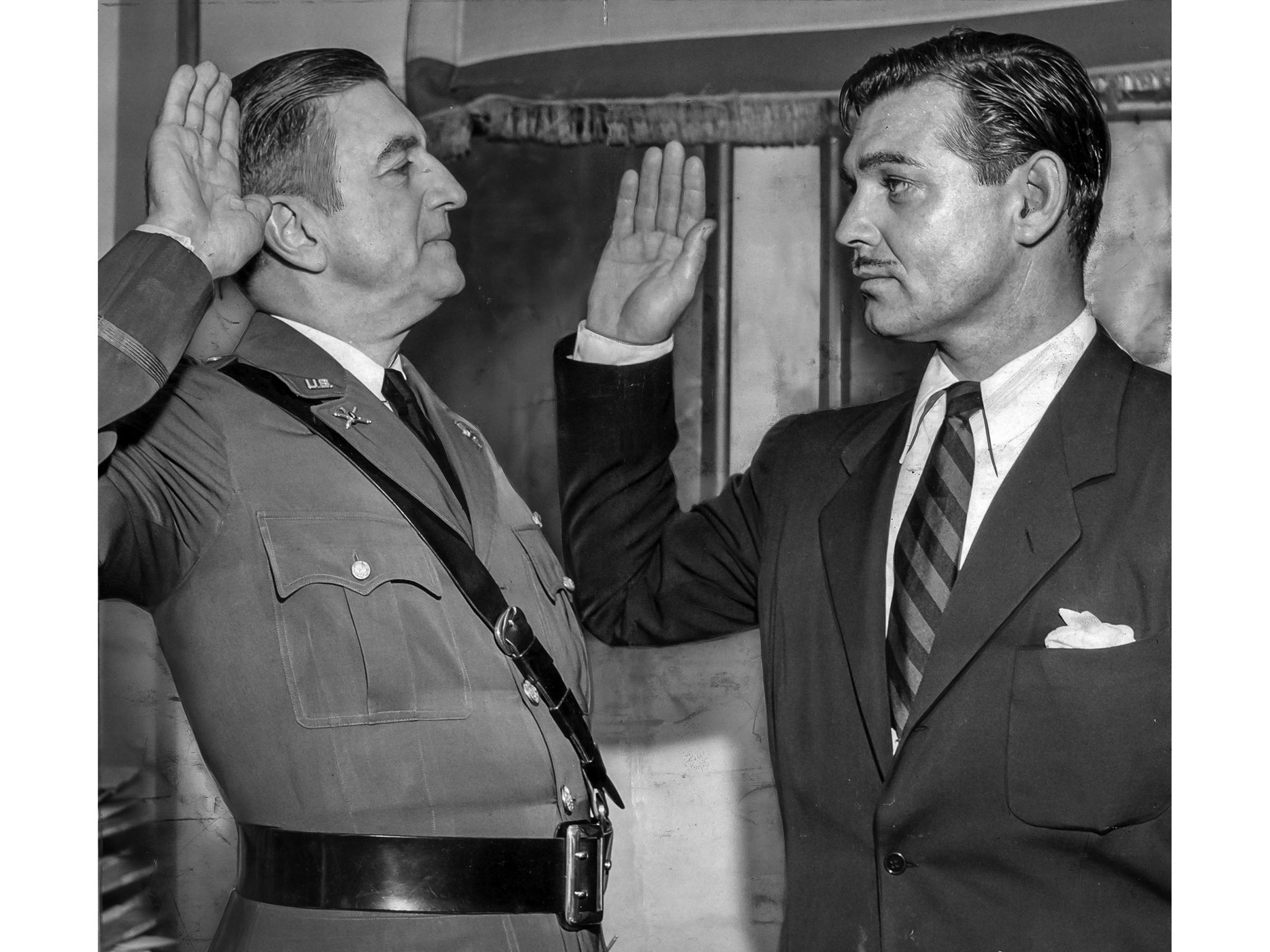 Aug. 12, 1942: Actor Clark Gable takes the oath as Army private from Col. Malcolm P. Andruss at the at t