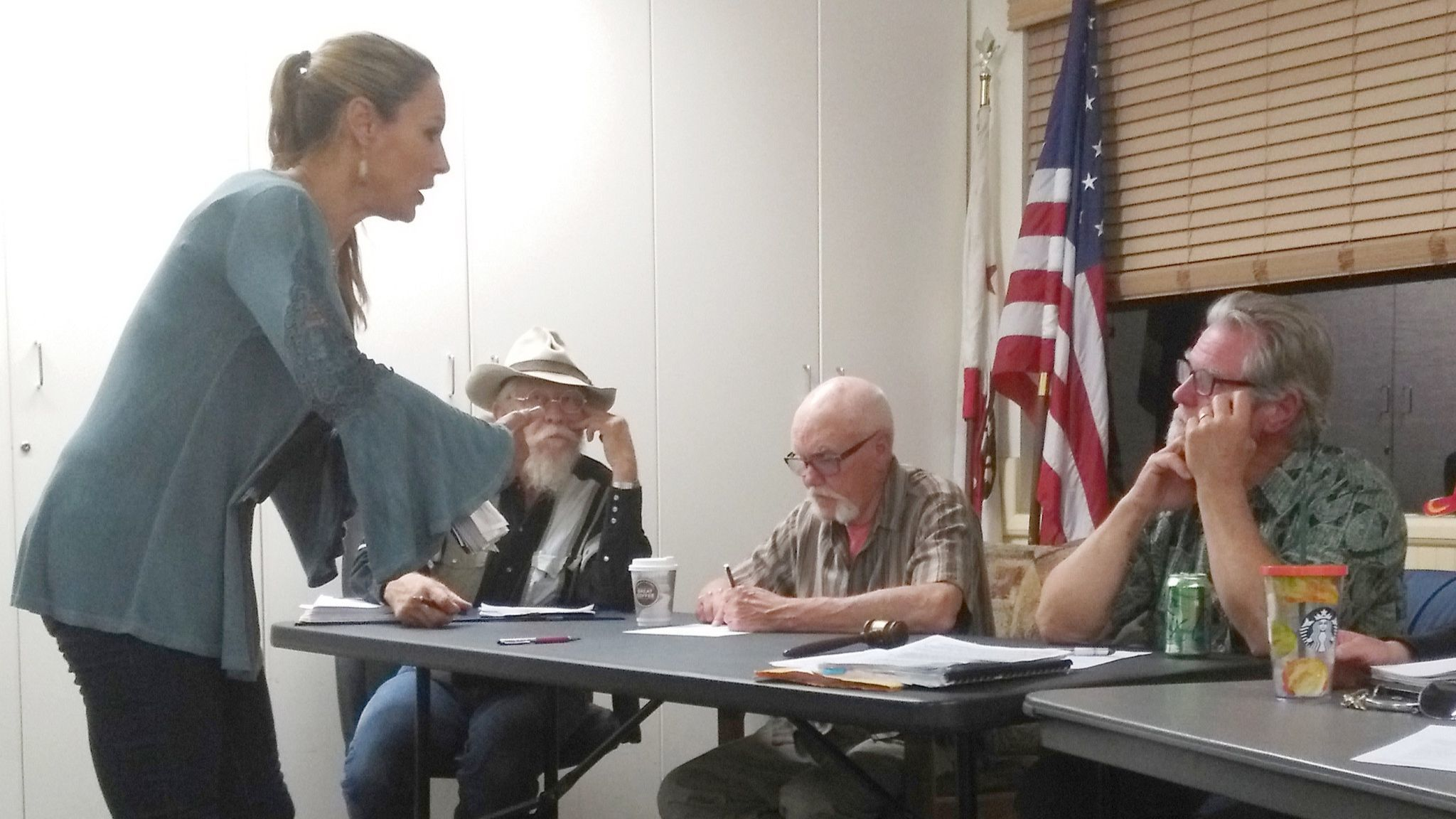On April 26, Clarice Cioe presents plans to the Ramona Design Review Board for a new fence, landscaping and water tower at a building proposed as a medical marijuana business.