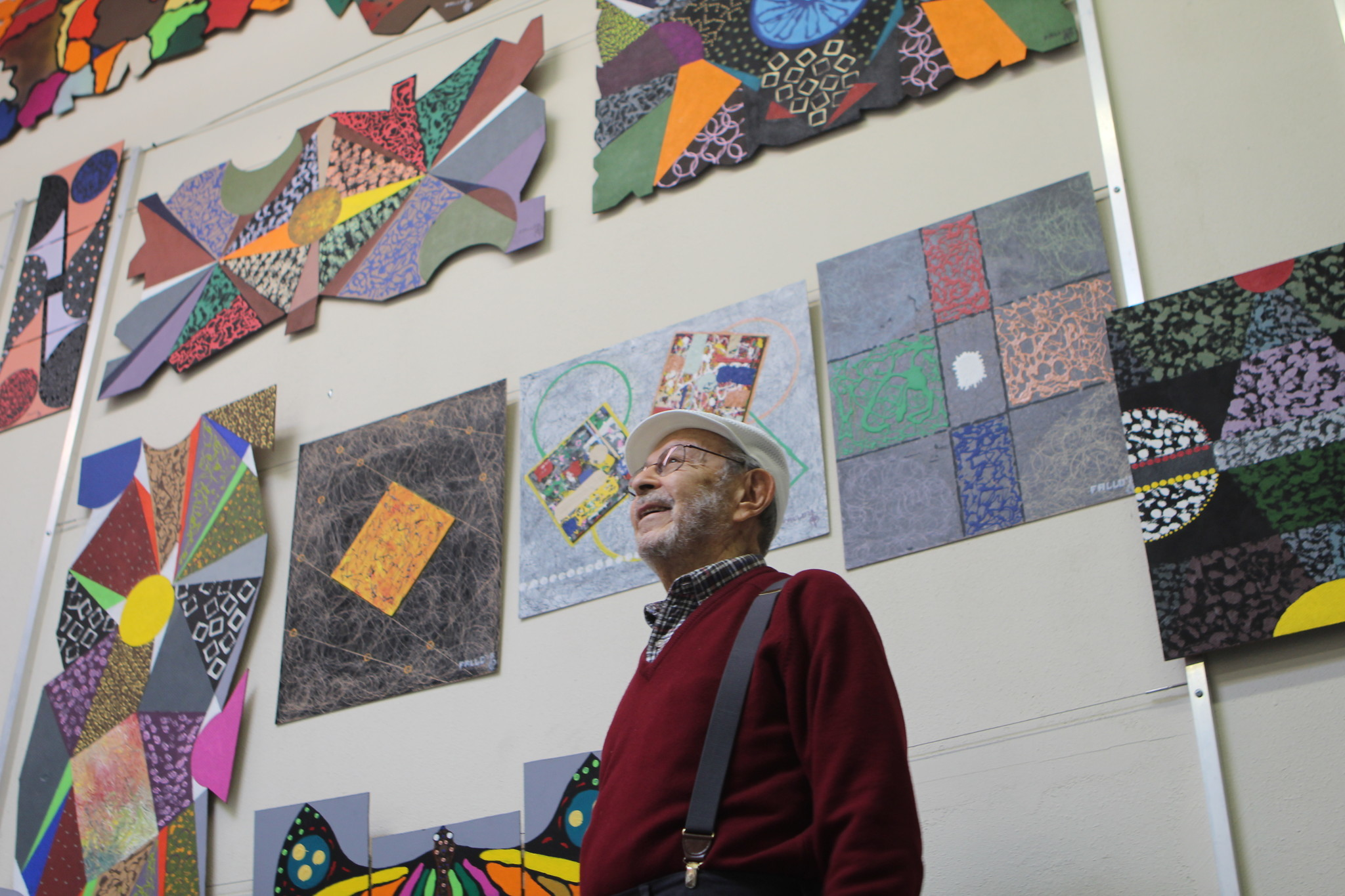 Mareyna, in his Miramar art studio, smiles as he narrates a tour of his old and new paintings.
