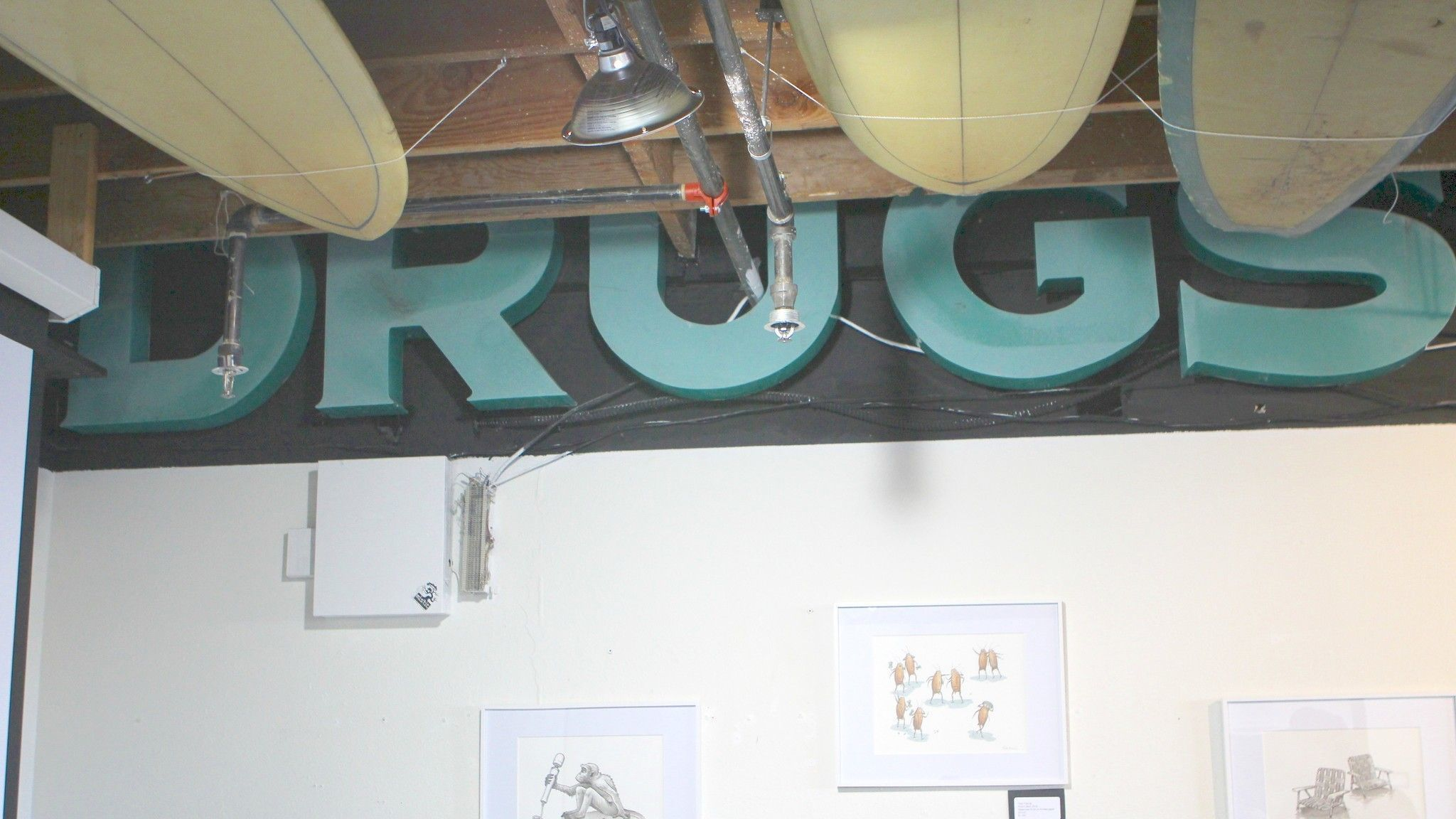 The second half of the Burns Drugs sign is preserved and on permanent display at the Misfit Pictures art gallery at 565 Pearl St. Co-owner Pierce Kavanagh paid $25 per letter to