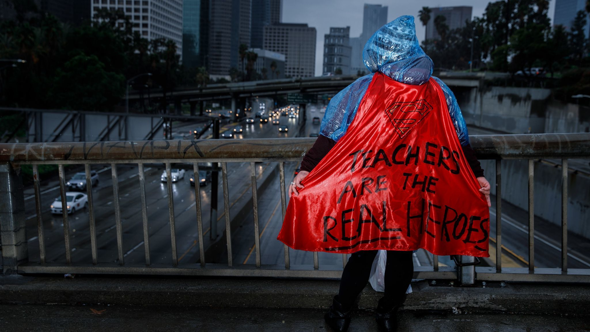 LOS ANGELES, CALIF. — MONDAY, JANUARY 14, 2019: A supporter for the UTLA strike sports a cape with