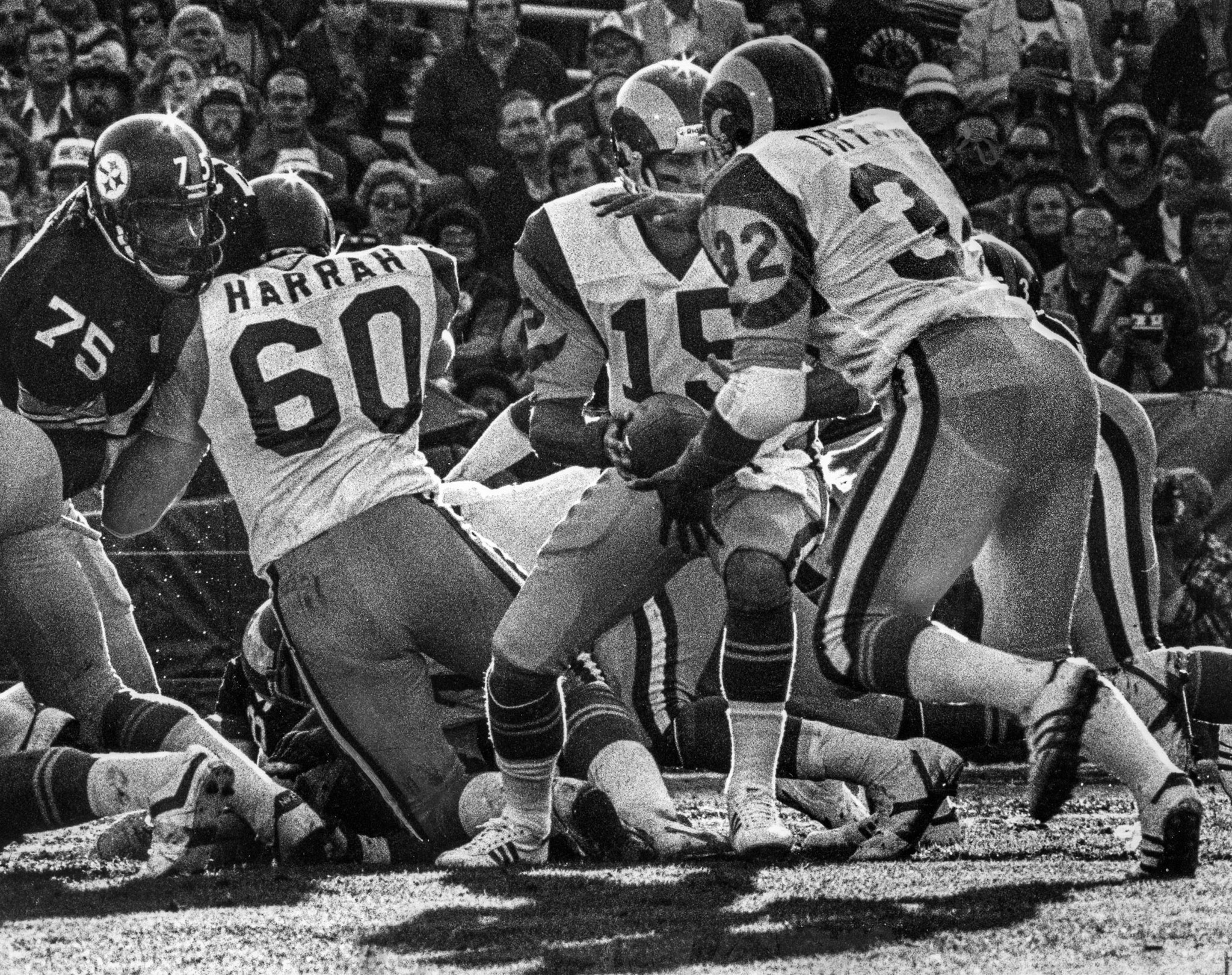 Jan. 20, 1980: Ram quarterback Vince Ferragamo hands off to Cullen Bryant as Dennis Harrah blocks Pi