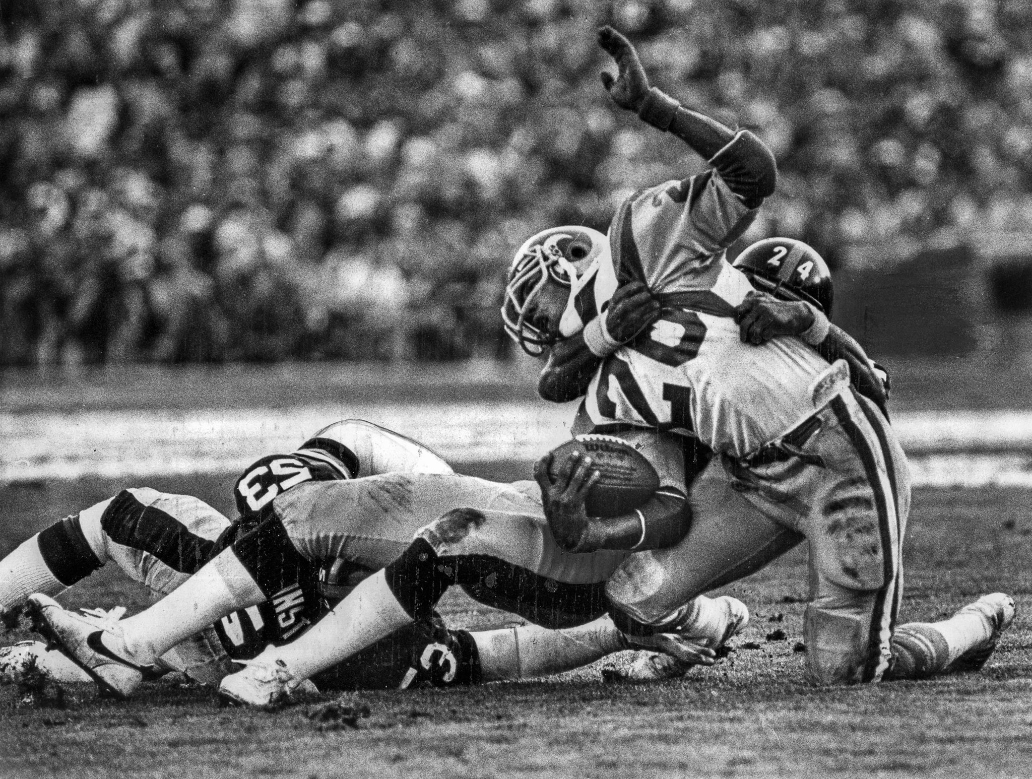 Jan. 20, 1980: Steeler defensive back J.T. Thomas wrestles Wendell Tyler to the turf, stopping the R