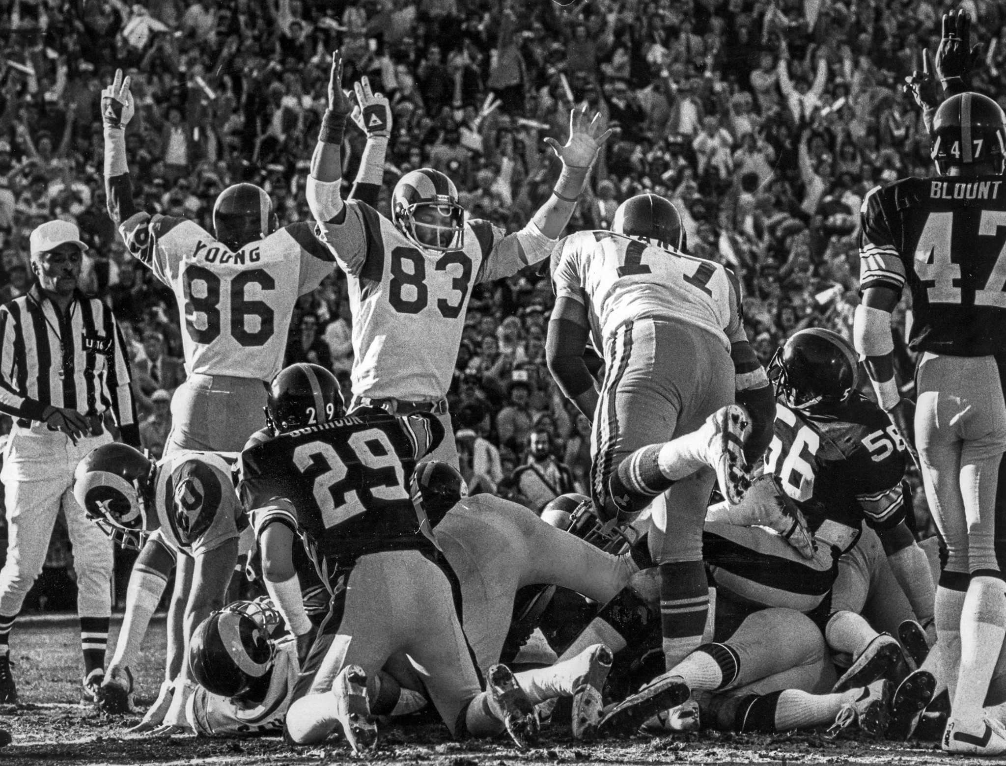 Jan. 20, 1980: Charle Young (86) and Terry Nelson (83) of the Rams signal touchdown after Cullen Bry