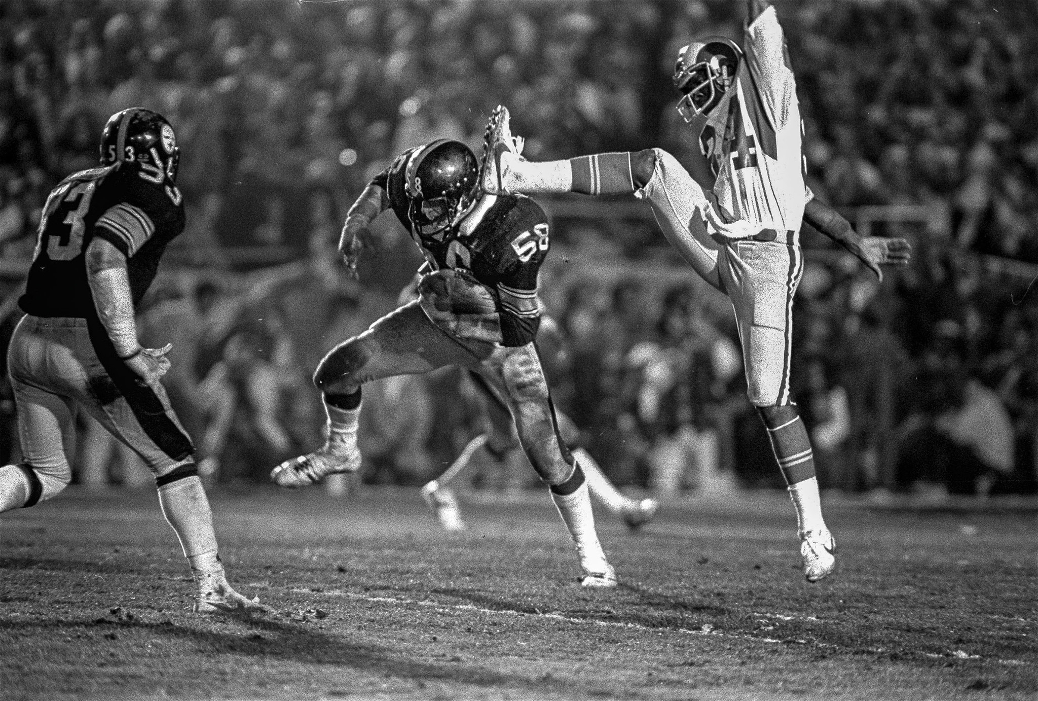 Pittsburgh Steelers linebacker Jack Lambert (58) comes down under the foot of Los Angeles Rams recei
