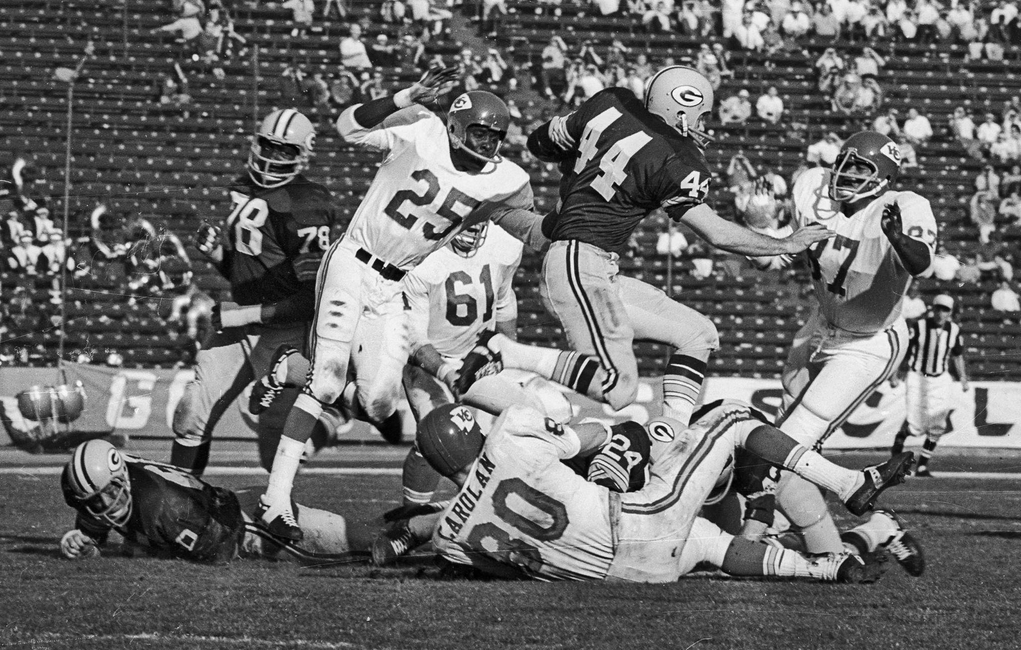 Jan. 15, 1967: Packers' halfback Donny Anderson, 44, running against Chiefs' Frank Pitts, 25, Denny