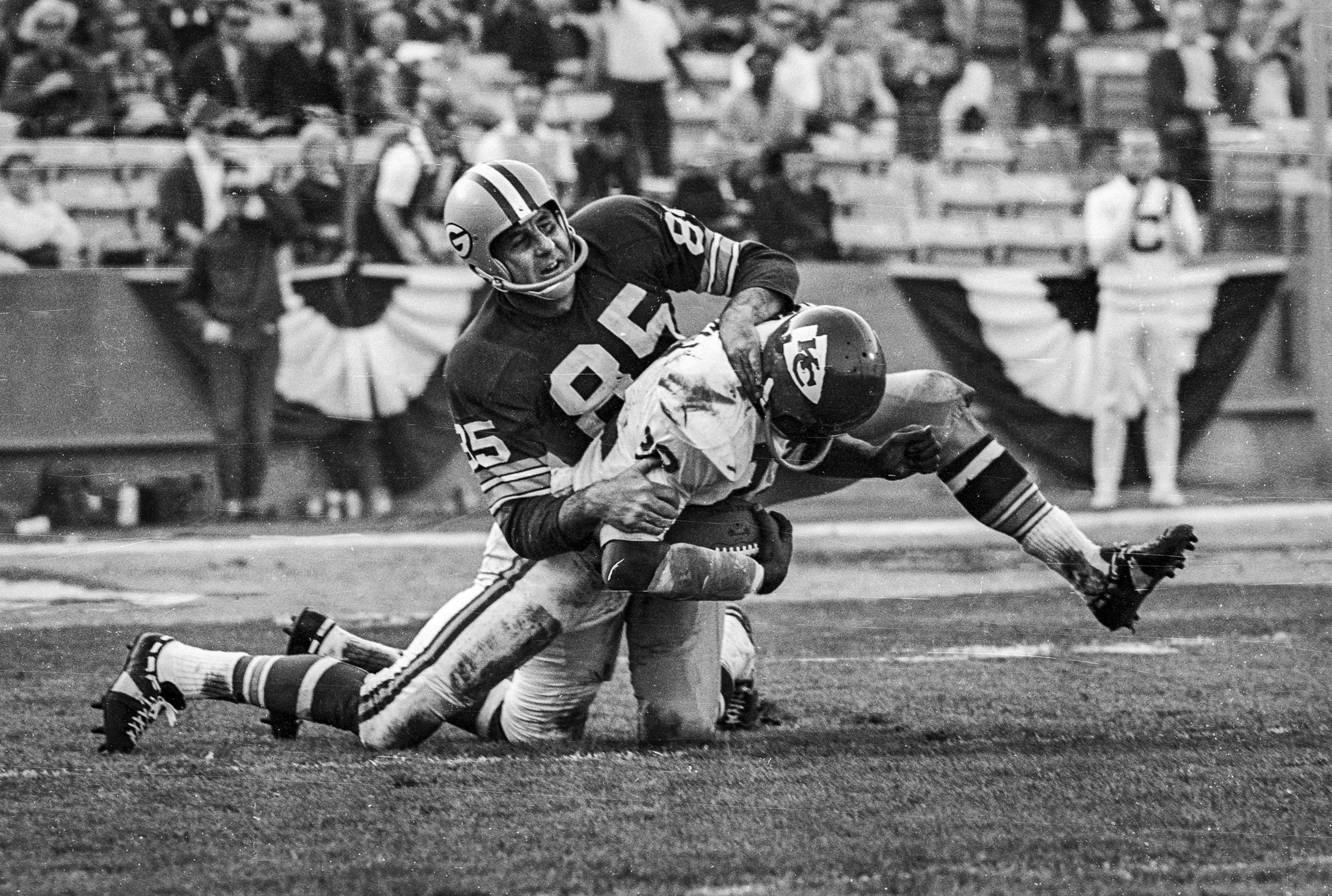 Jan. 15, 1967: Packers receiver Max McGee, 85, secures tackle of Chiefs Willie Mitchell following in