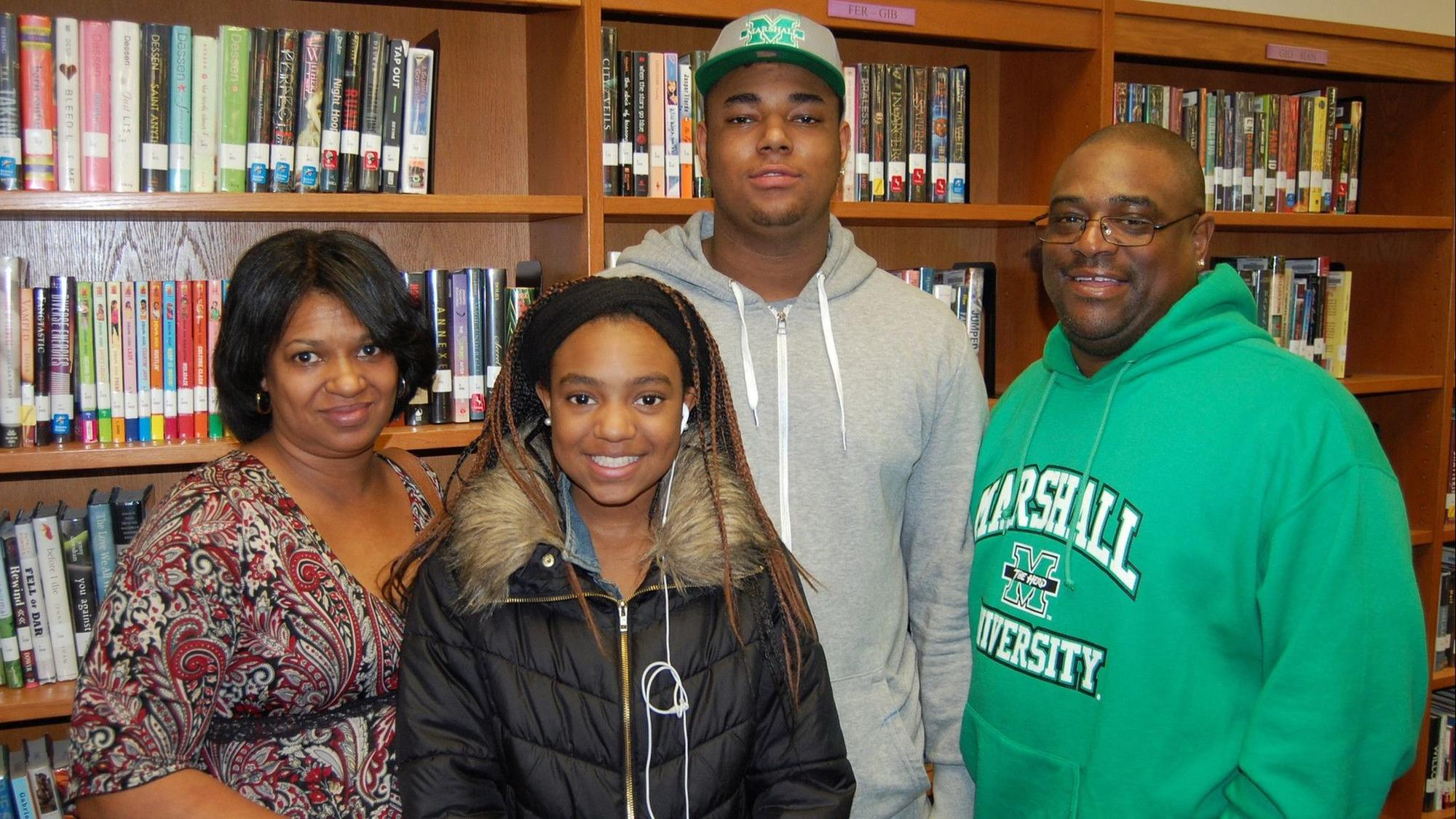 Larry Aaron III and his family on signing day