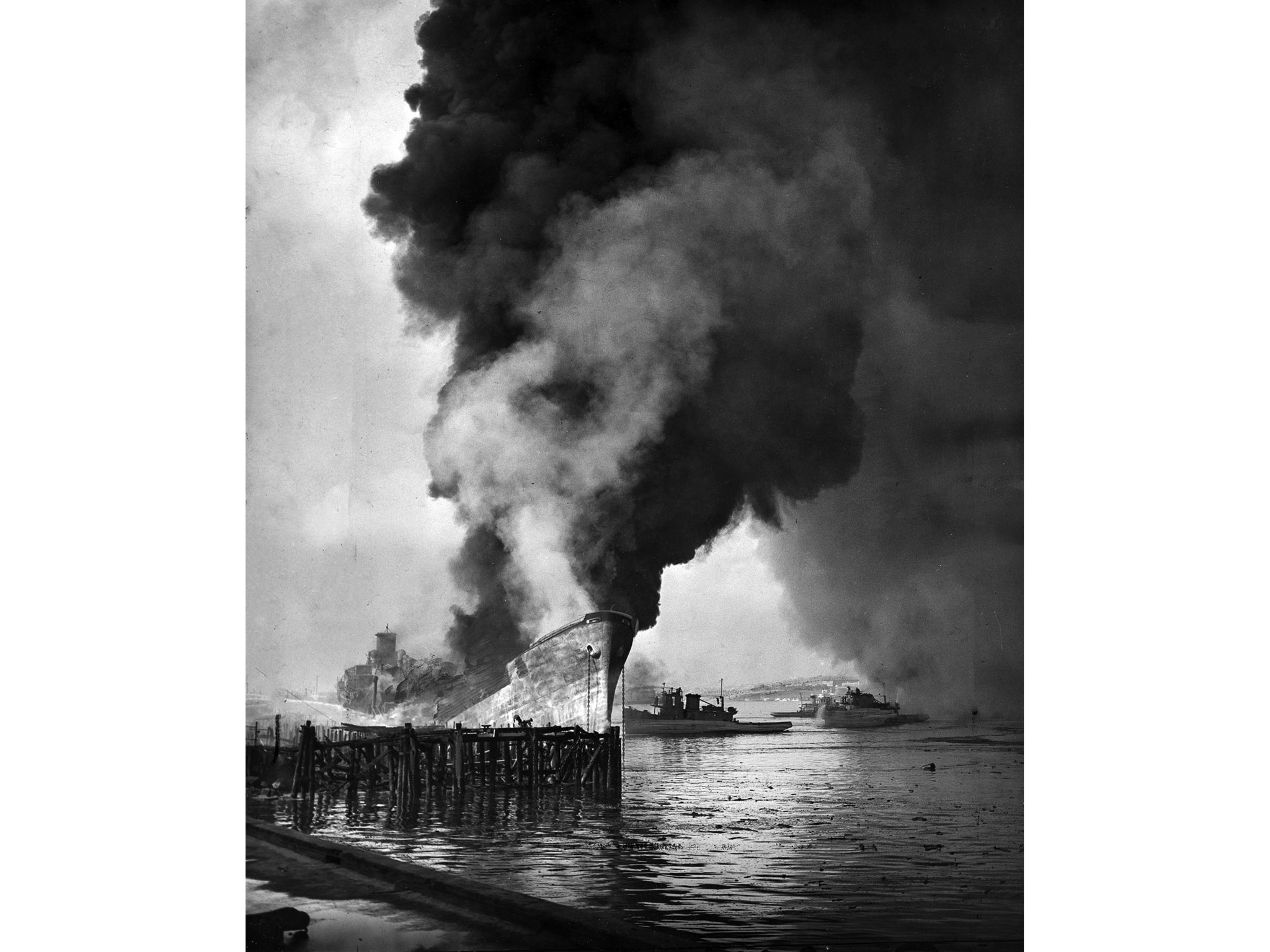 June 22, 1947: The remains of the tanker Markay burn at Los Angeles Harbor following explosion.