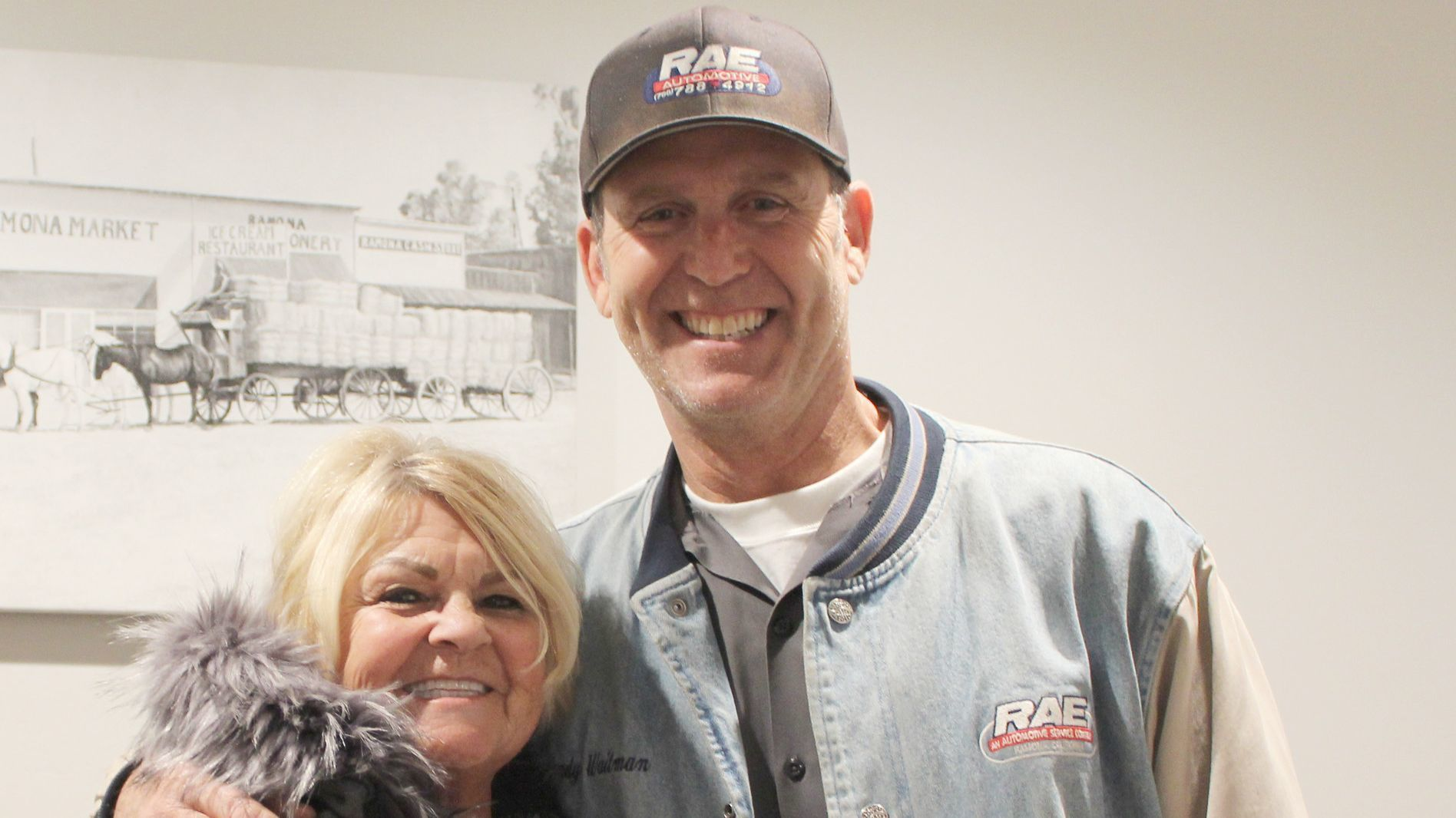 Sally Westbrook, chamber past president, visits with Randy Waitman of R.A.E. Automotive and Randy Waitman Motorsports.