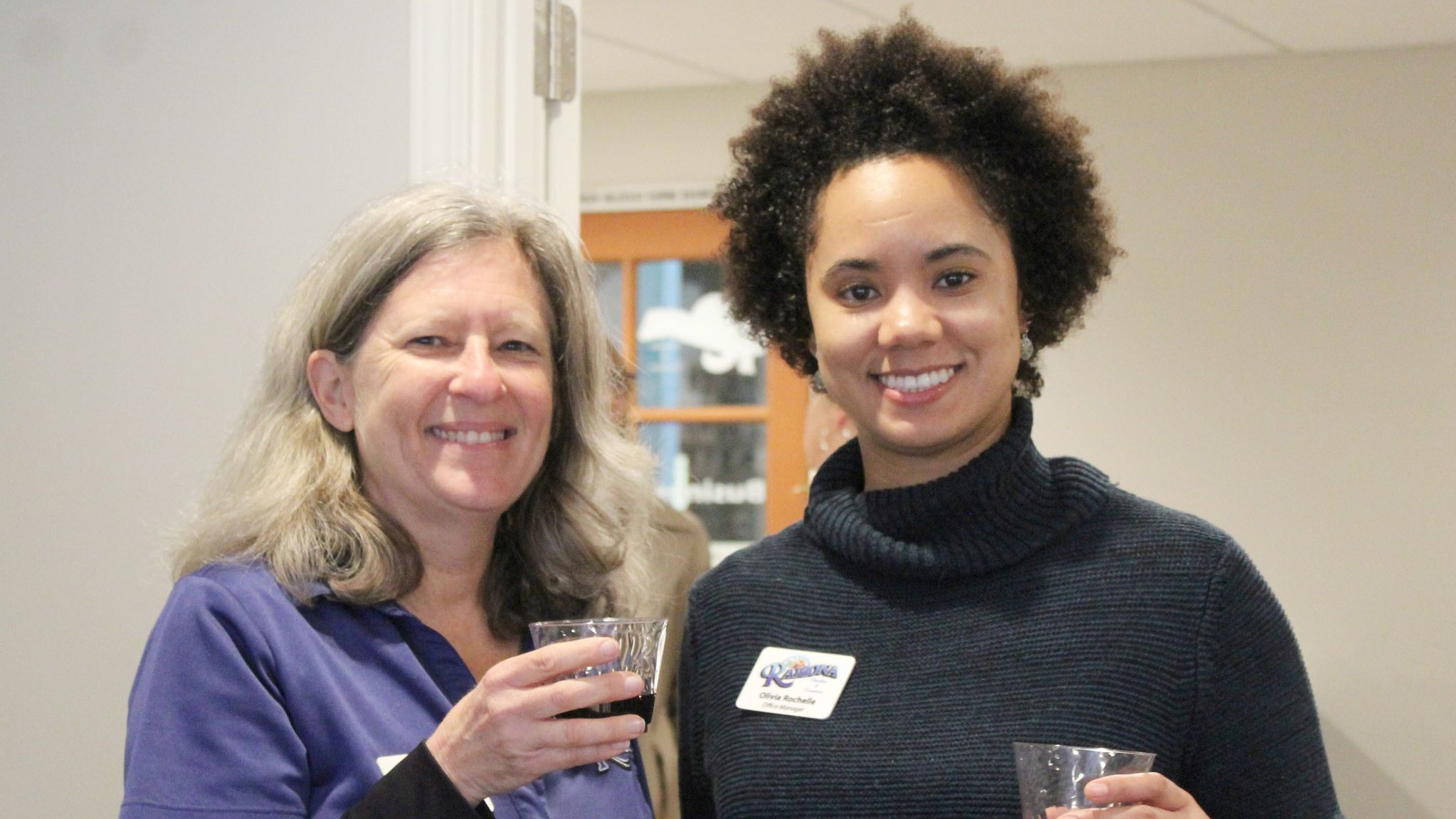 Ramona Chamber Administrative Assistant Michelle Sund, left, and Office Manager Olivia Rochelle greet guests at the open house.