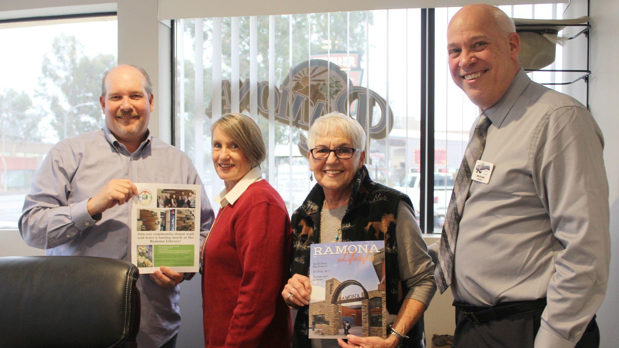 Joe Stupar, left, Ramona chamber's executive director, and Bob Krysak, chamber president, visit with Friends of Ramona Library President Debby Novak, Membership Chair Patsy Heald.