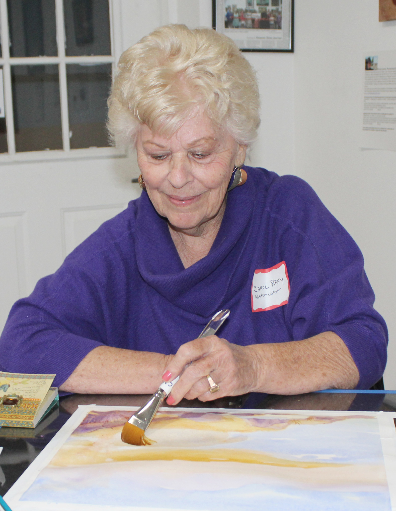 Artist Carol Ravy works on a watercolor during the First Friday event in January. The next First Friday Art party will be from 6 to 8 p.m. Feb. 1.