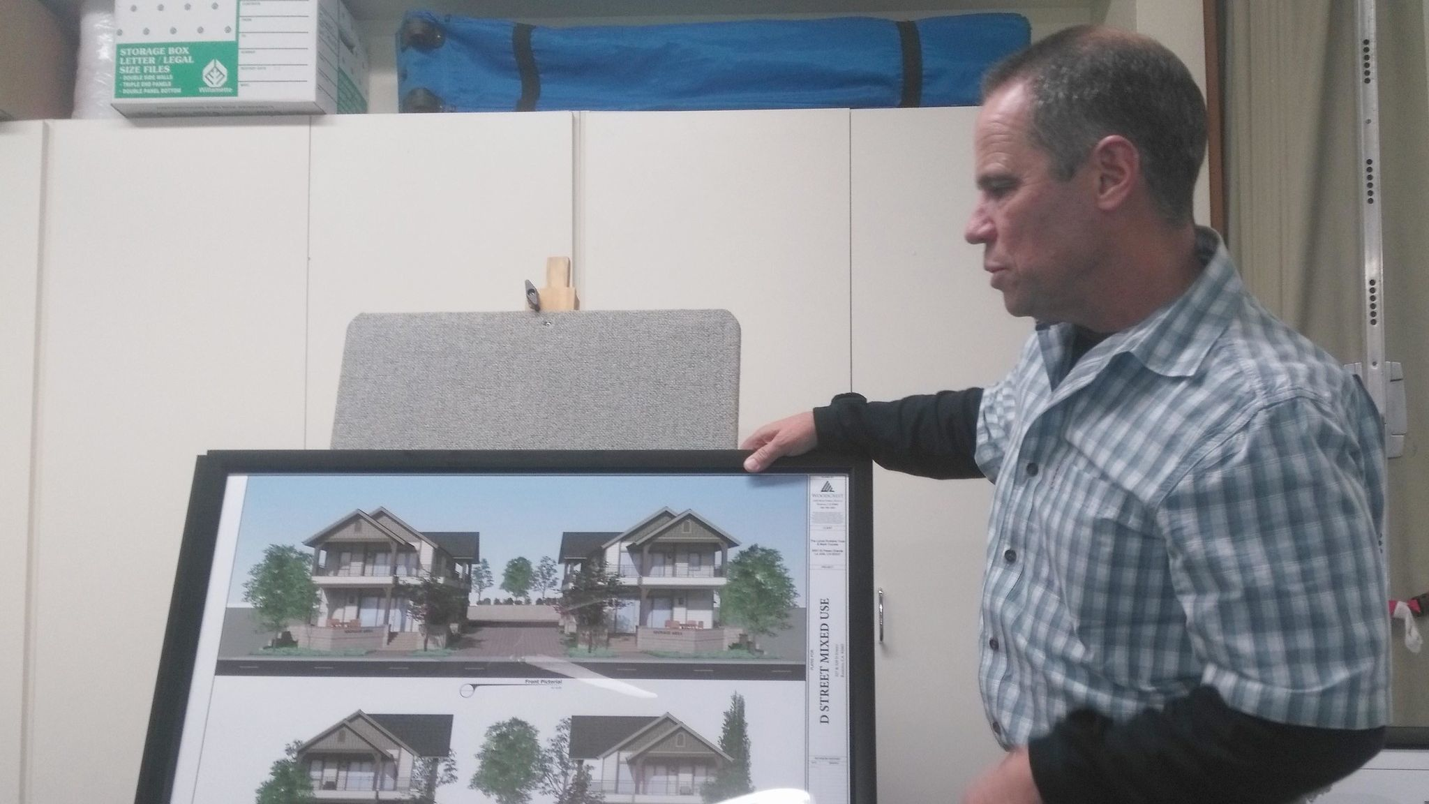 Steve Powell of Woodcrest Companies presents renderings of two identical mixed-use projects accommodating retail on the ground floor and residential above.