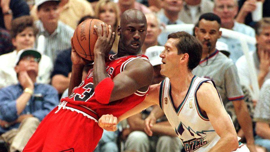 Michael Jordan of the Chicago Bulls backs into Jeff Hornacek of the Utah Jazz during the second half of game five of the 1997 NBA Finals
