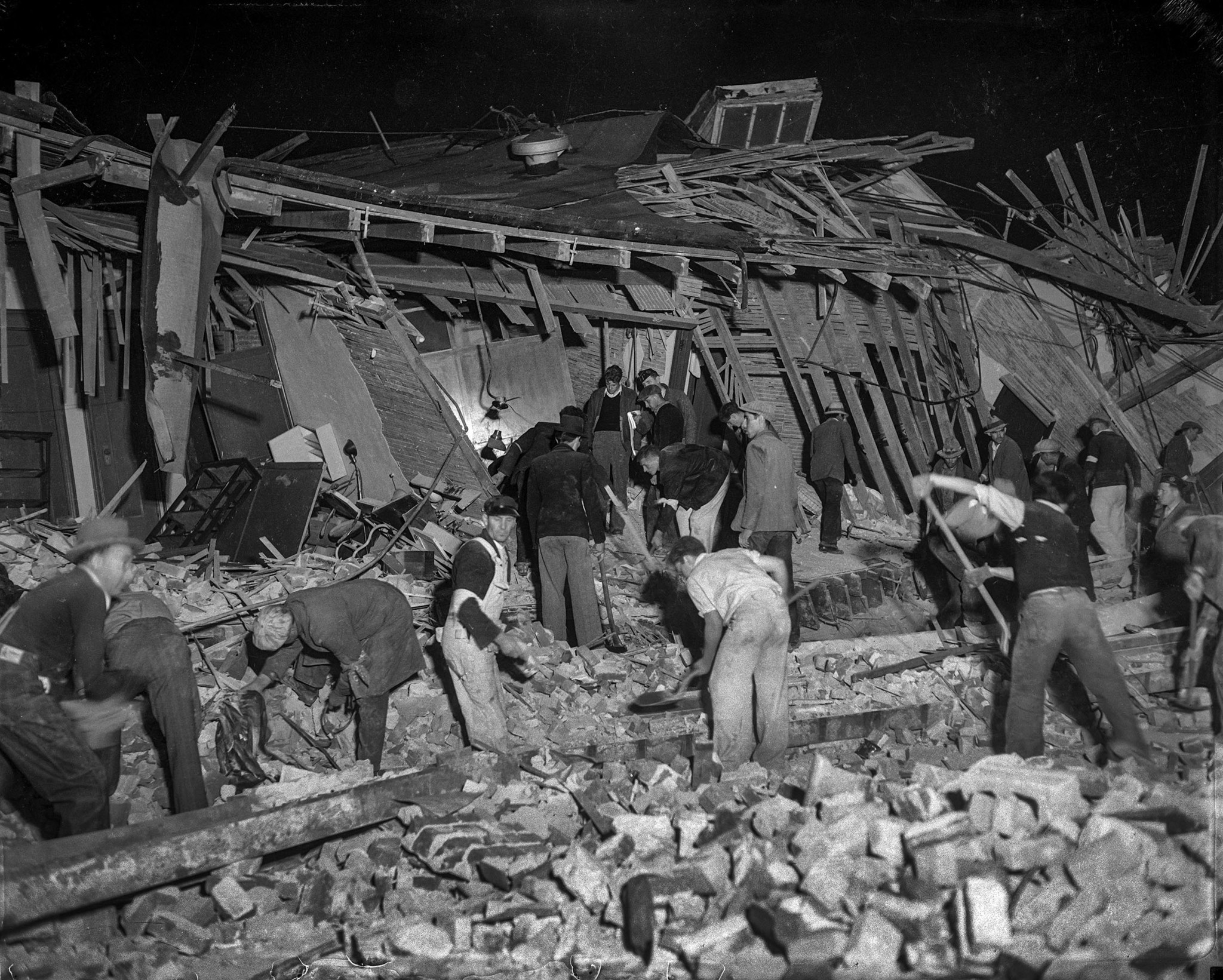 Workers going through the rubble of a ruined building after the March 10, 1933, Long Beach earthquak