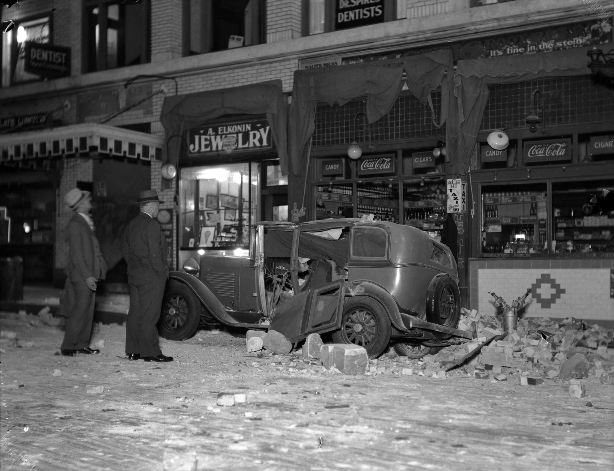 March 10, 1933: Building and automobile on Beacon Street in San Pedro damaged by the Long Beach eart