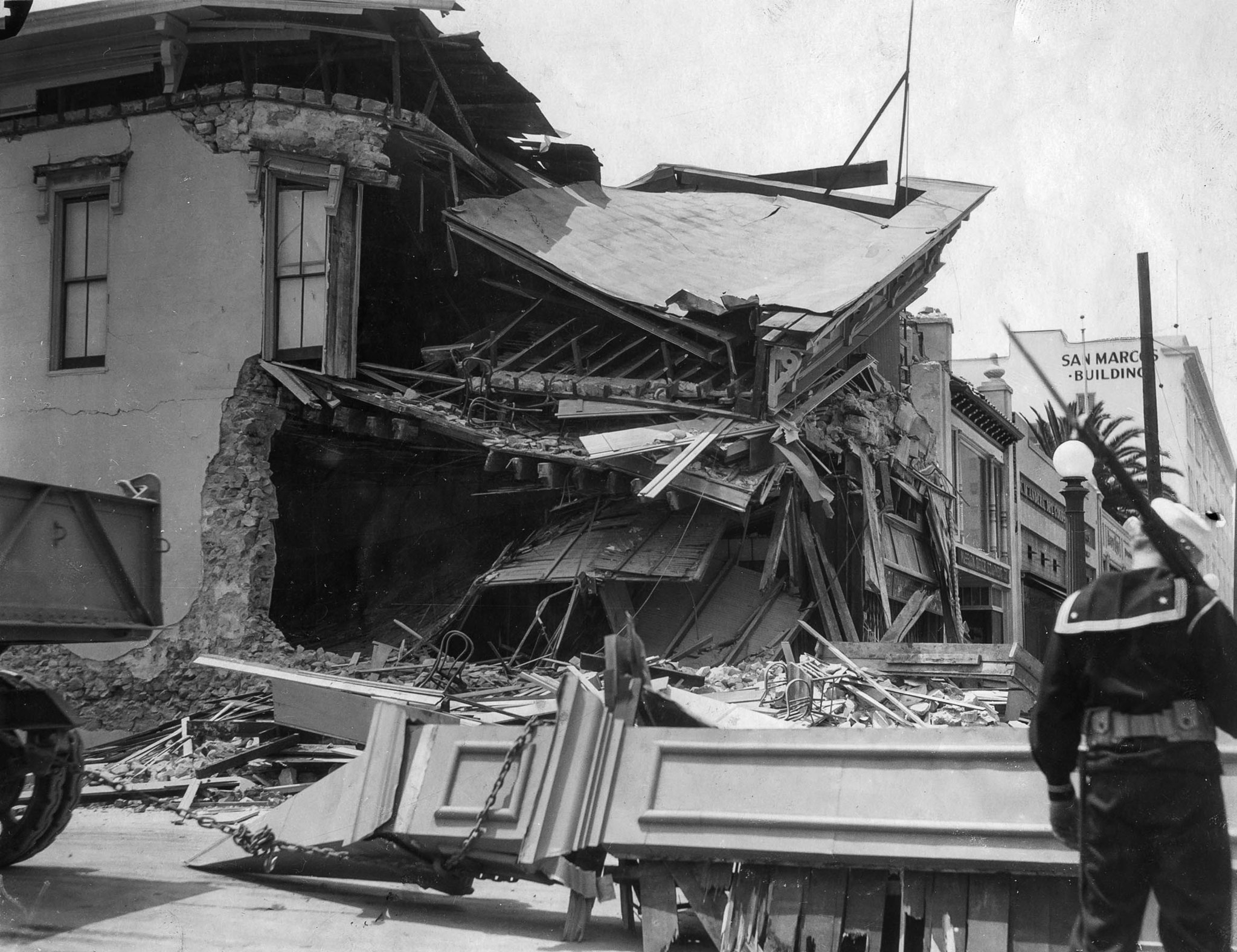 Navy sailor patroling Long Beach following the March 10, 1933, earthquake. This photo appeared in th