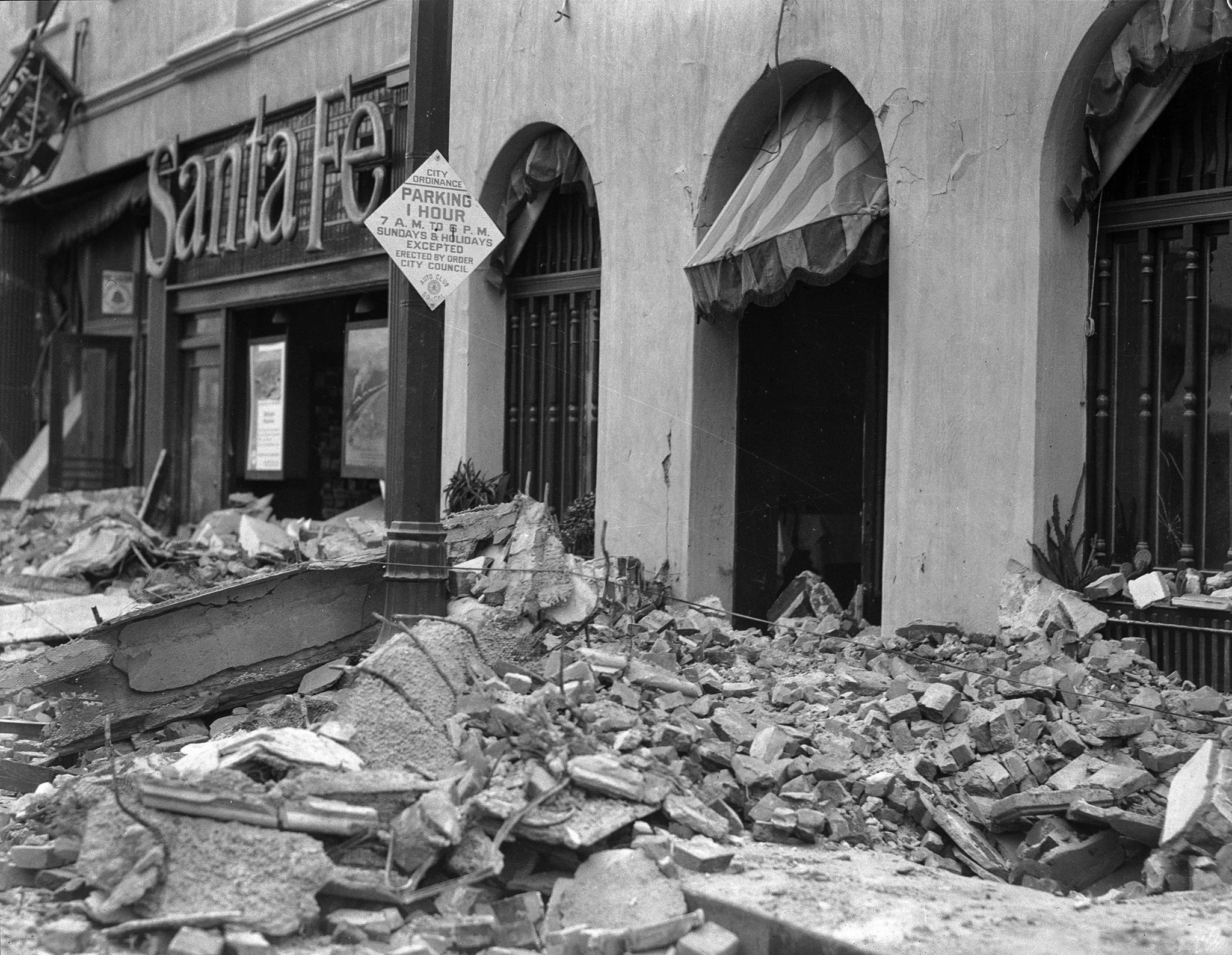 Earthquake-damaged building occupied by the Rossmore Hotel, Santa Ana, 1933. View of the earthquake-