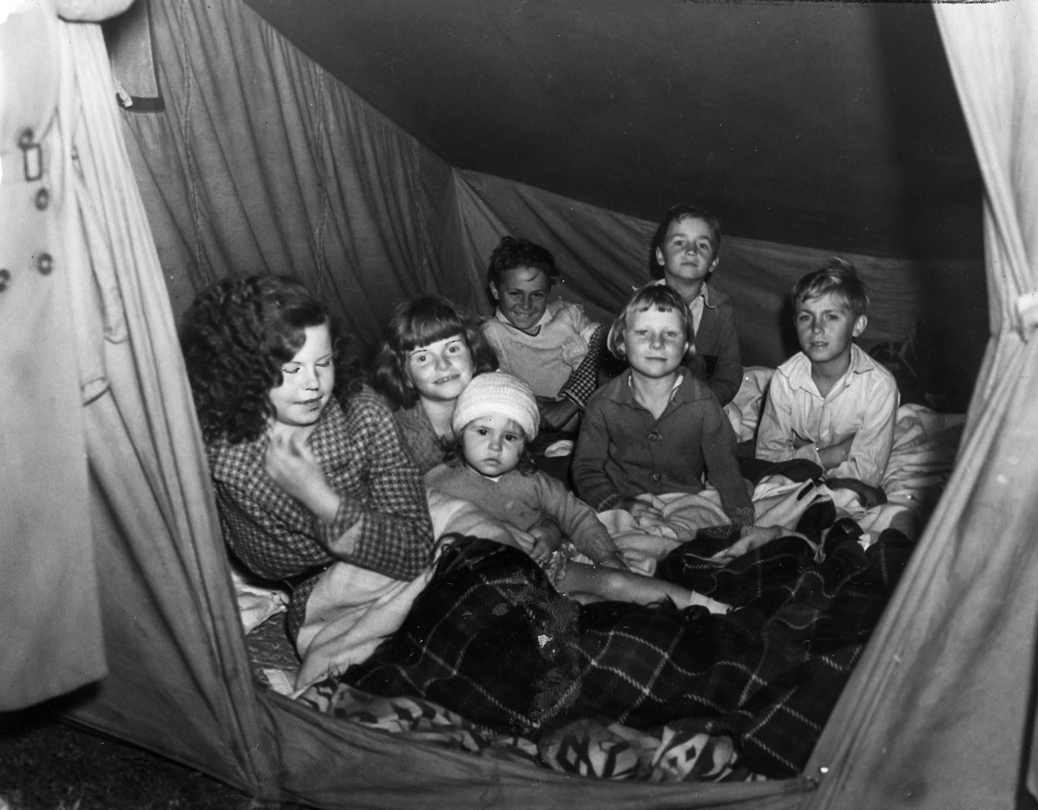 Victims of the March 10, 1933, Long Beach Earthquake find temporary shelter in a tent. This photo ap