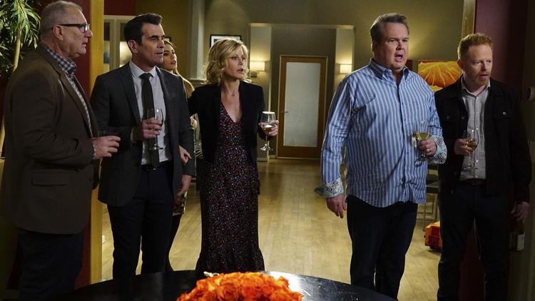 This image released by ABC shows, from left, Ed O'Neill, Ty Burrell, Sofia Vergara, obscured, Julie