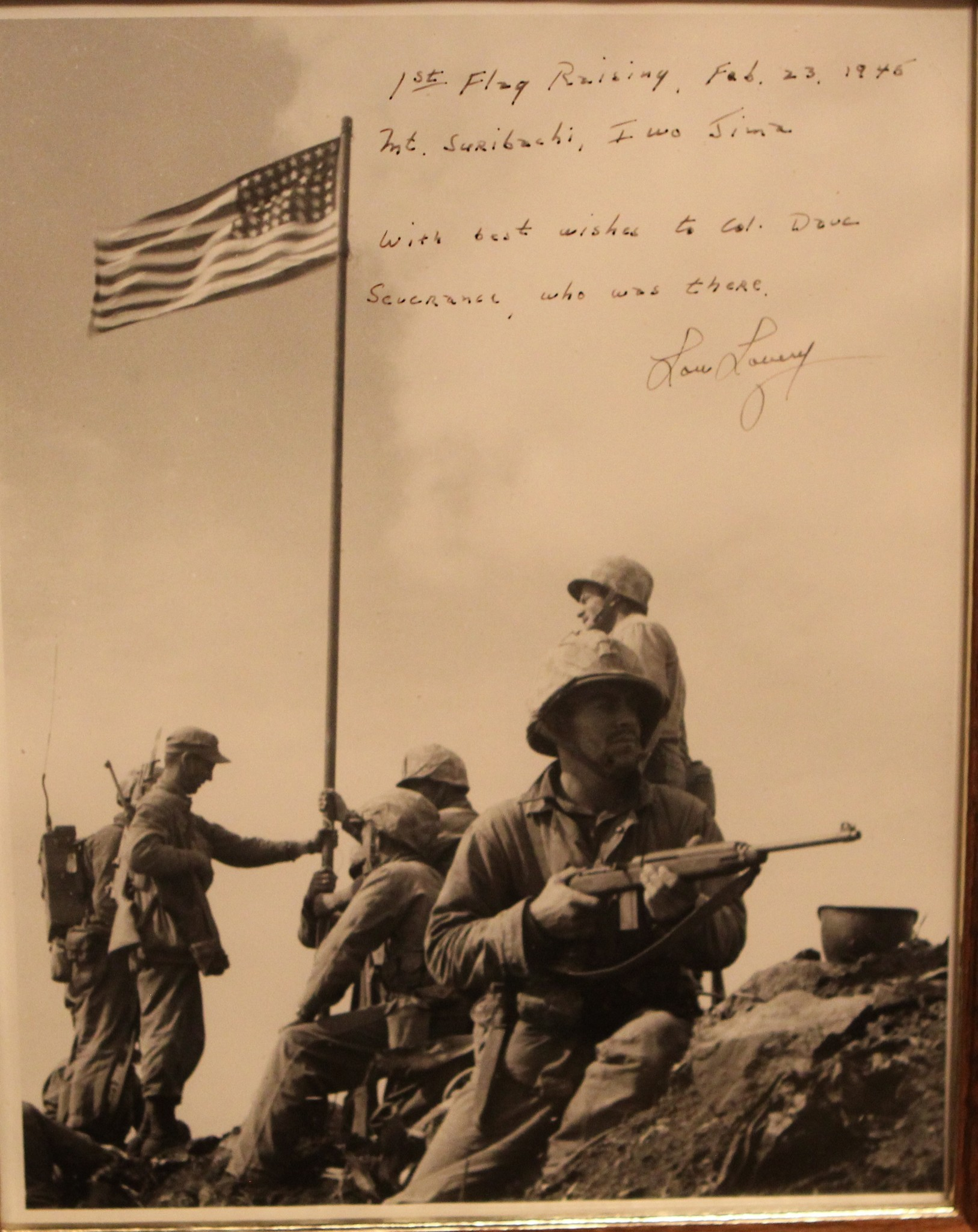 The actual first Iwo Jima flag-raising, as photographed by Lou Lowery, who signed this copy