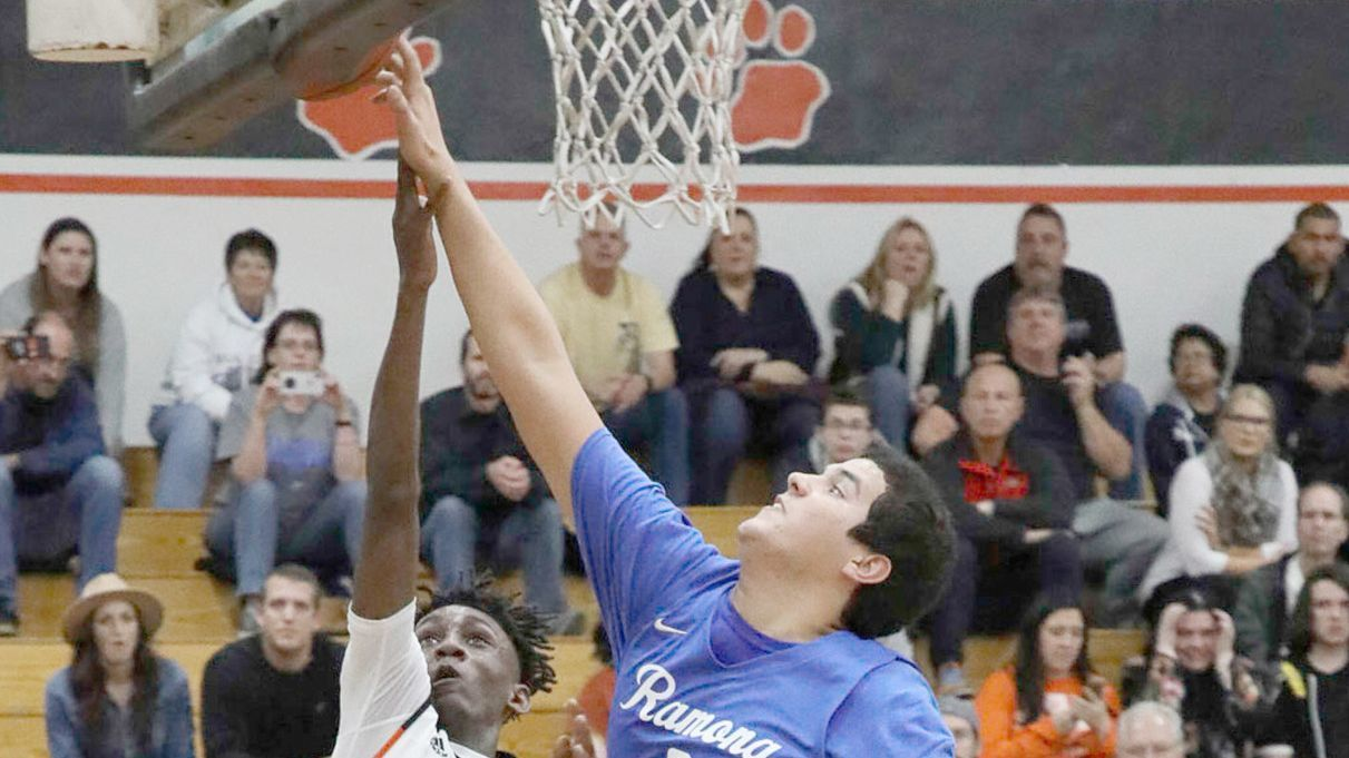 Zach Balcone, who knocks down 15 points in Friday's game, reaches for the basket.